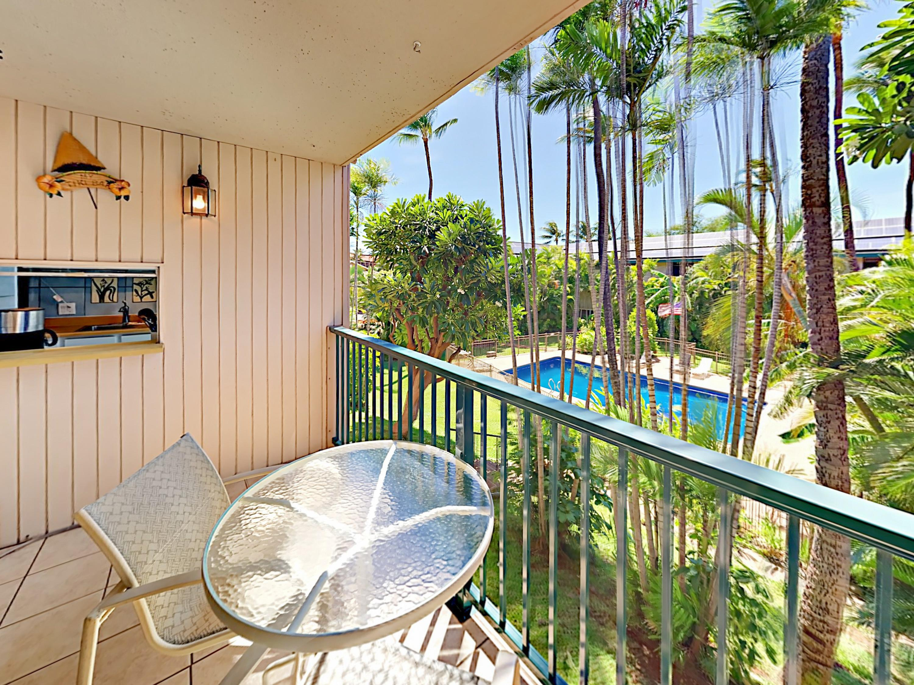 Step outside to the private balcony that overlooks the shared pool.