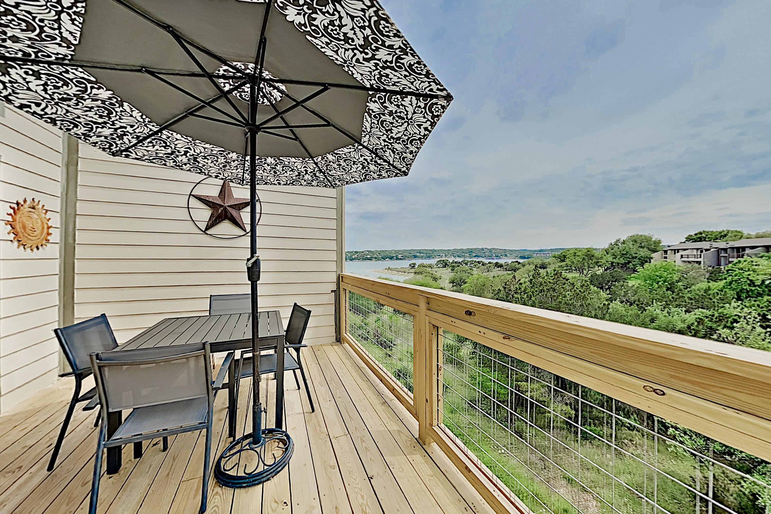 Take in views of Lake Travis and the greenbelt from your 2nd-story balcony.