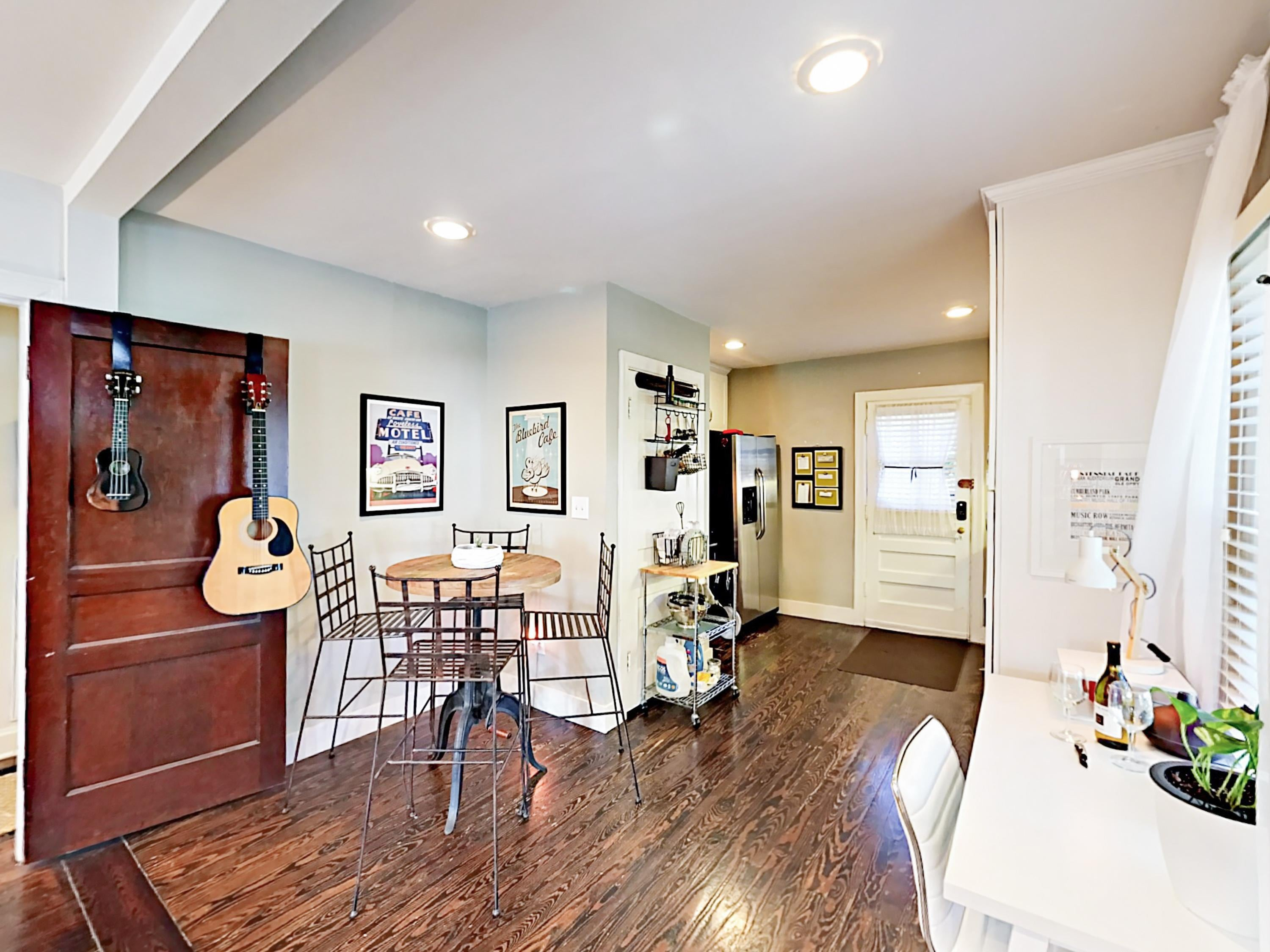 Original refinished hardwood floors and contemporary decor infuse the bungalow with both modern and vintage character.