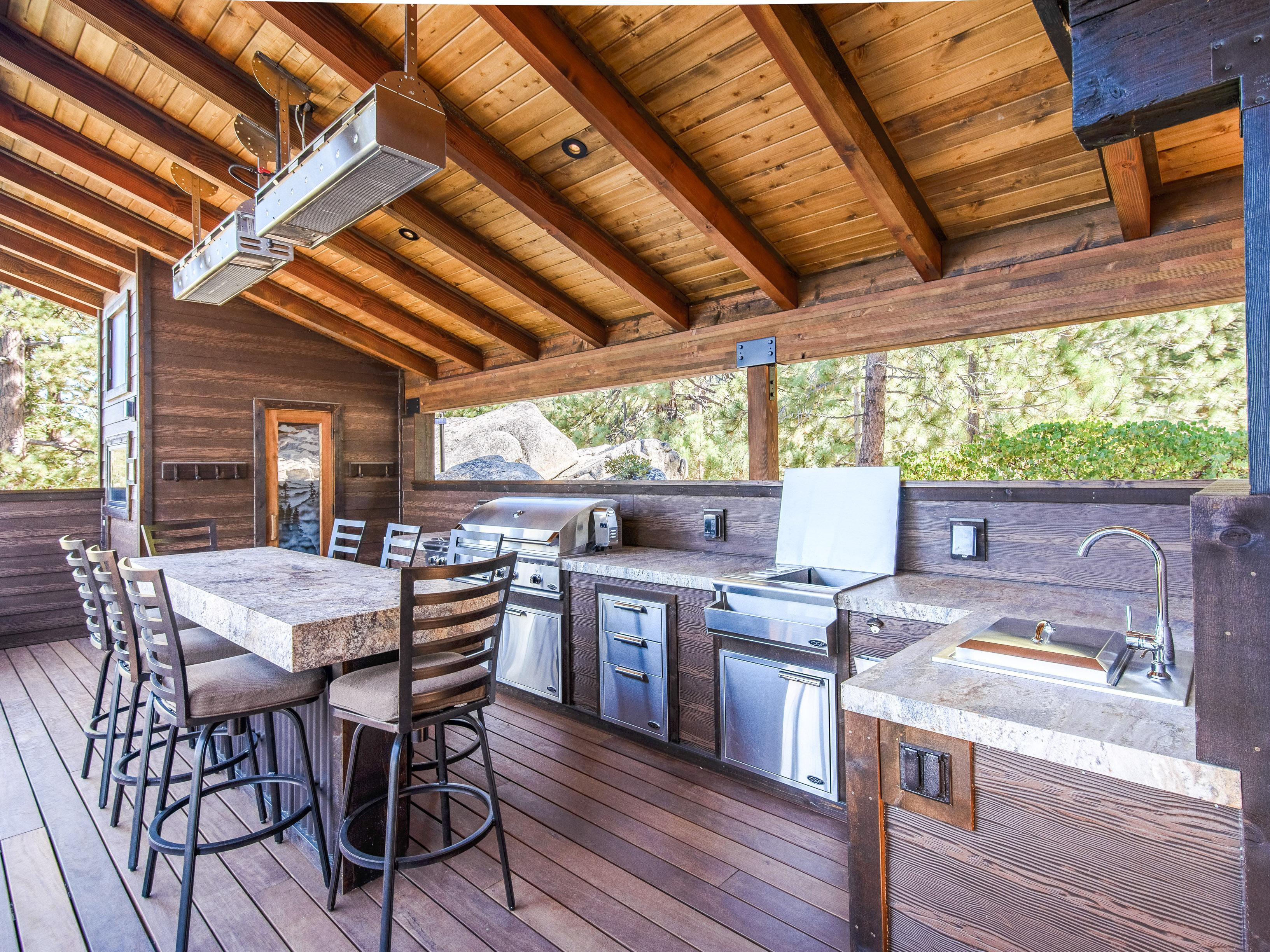 A full outdoor kitchen and 10-person granite table await on the deck.