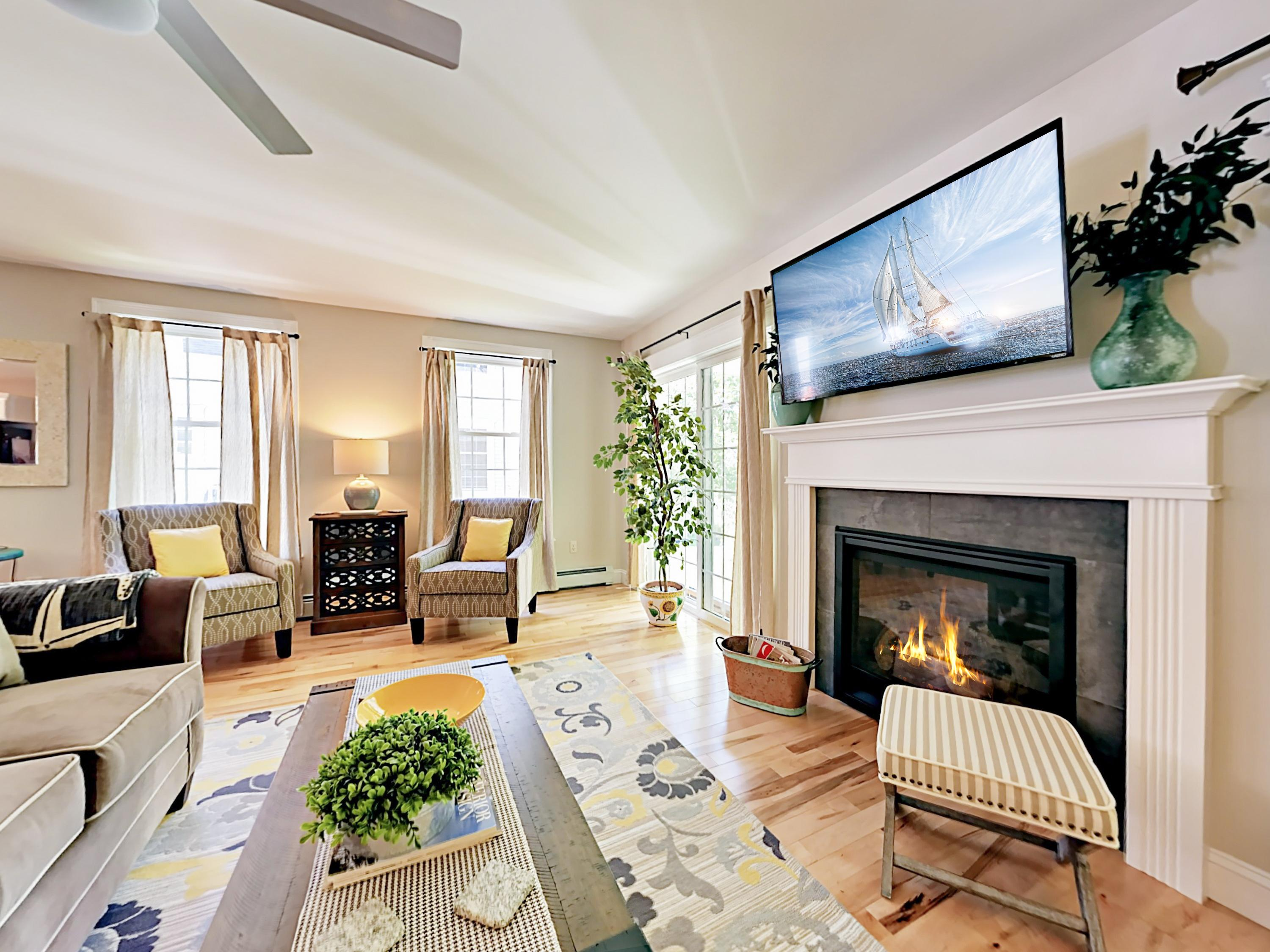 "Hardwood floors gleam in the living room, where there's seating for 5 around a gas fireplace and 52"" TV."
