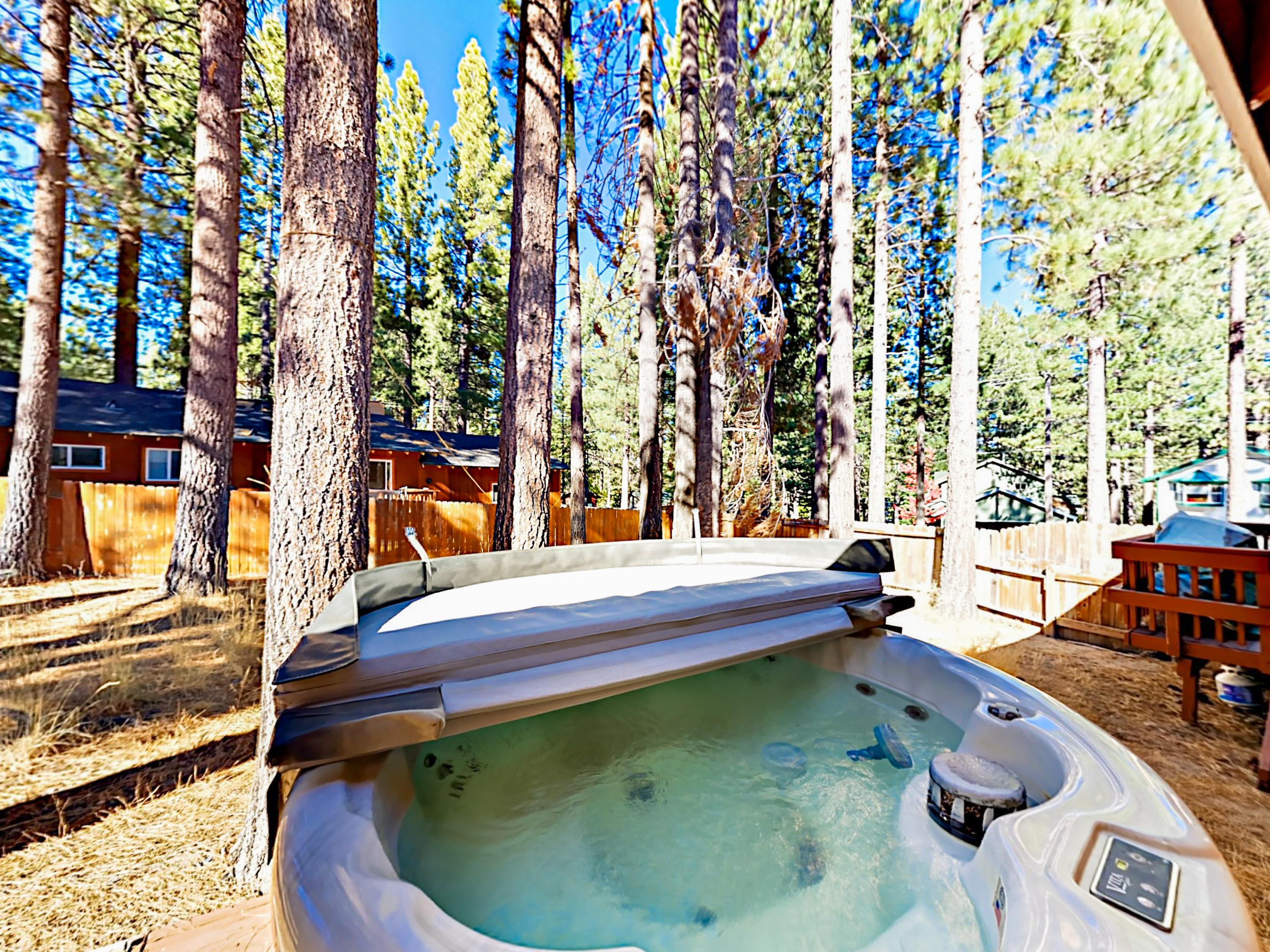 Relax and unwind in the private 4-person hot tub on the deck.