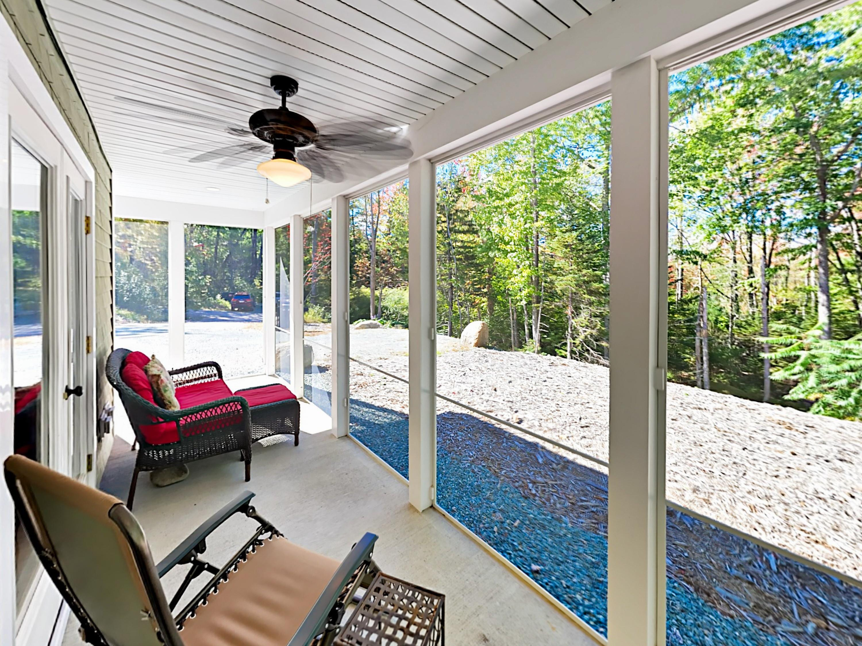 Take in forested vistas from the screened patio.