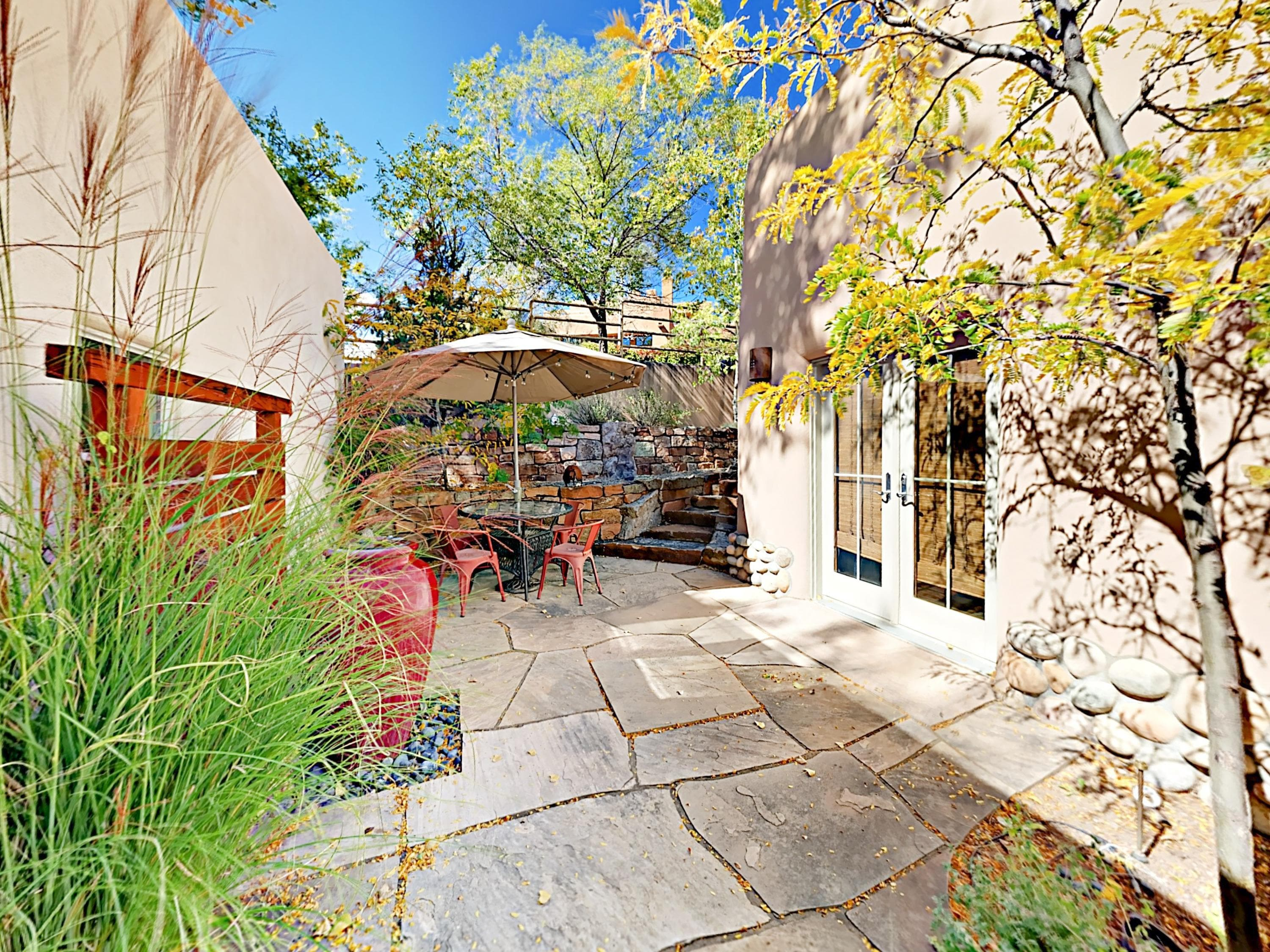 The private wraparound flagstone patio is the perfect place to unwind.