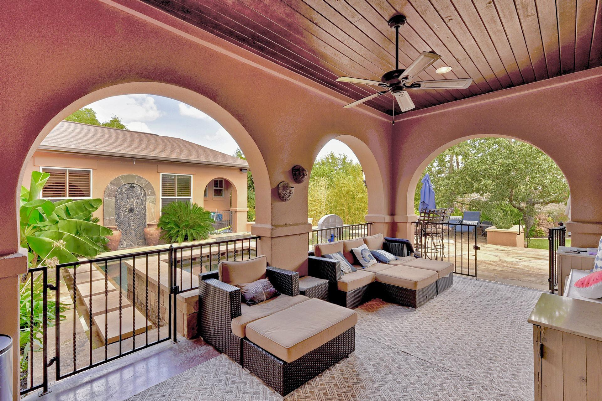 With cushioned seating and a ceiling fan, the covered patio offers an inviting space to unwind.