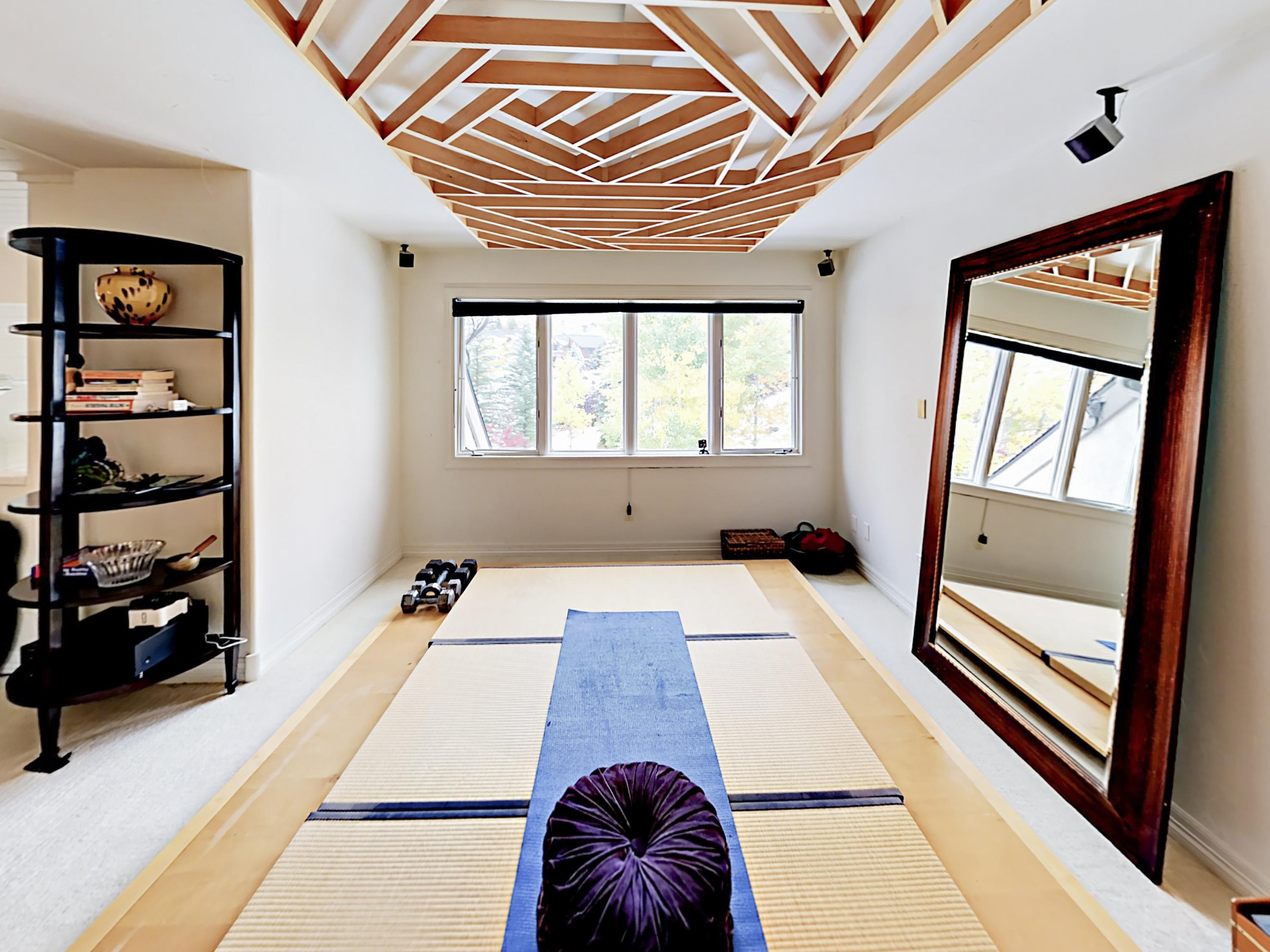Upstairs, you'll find this tranquil yoga space.