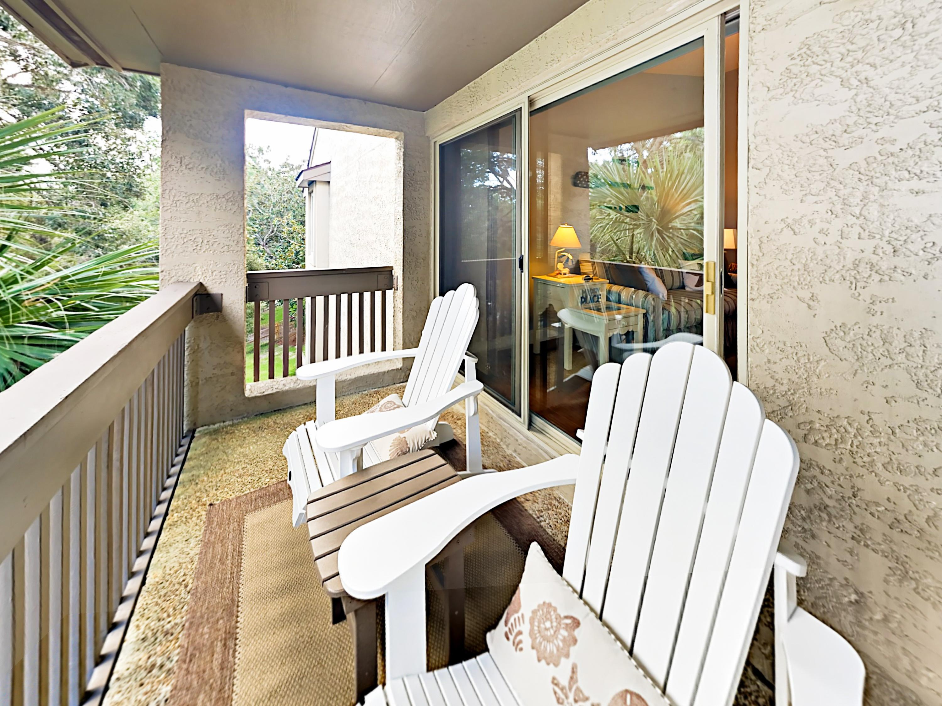 Enjoy the breeze on the private balcony, furnished with 2 Adirondack chairs.
