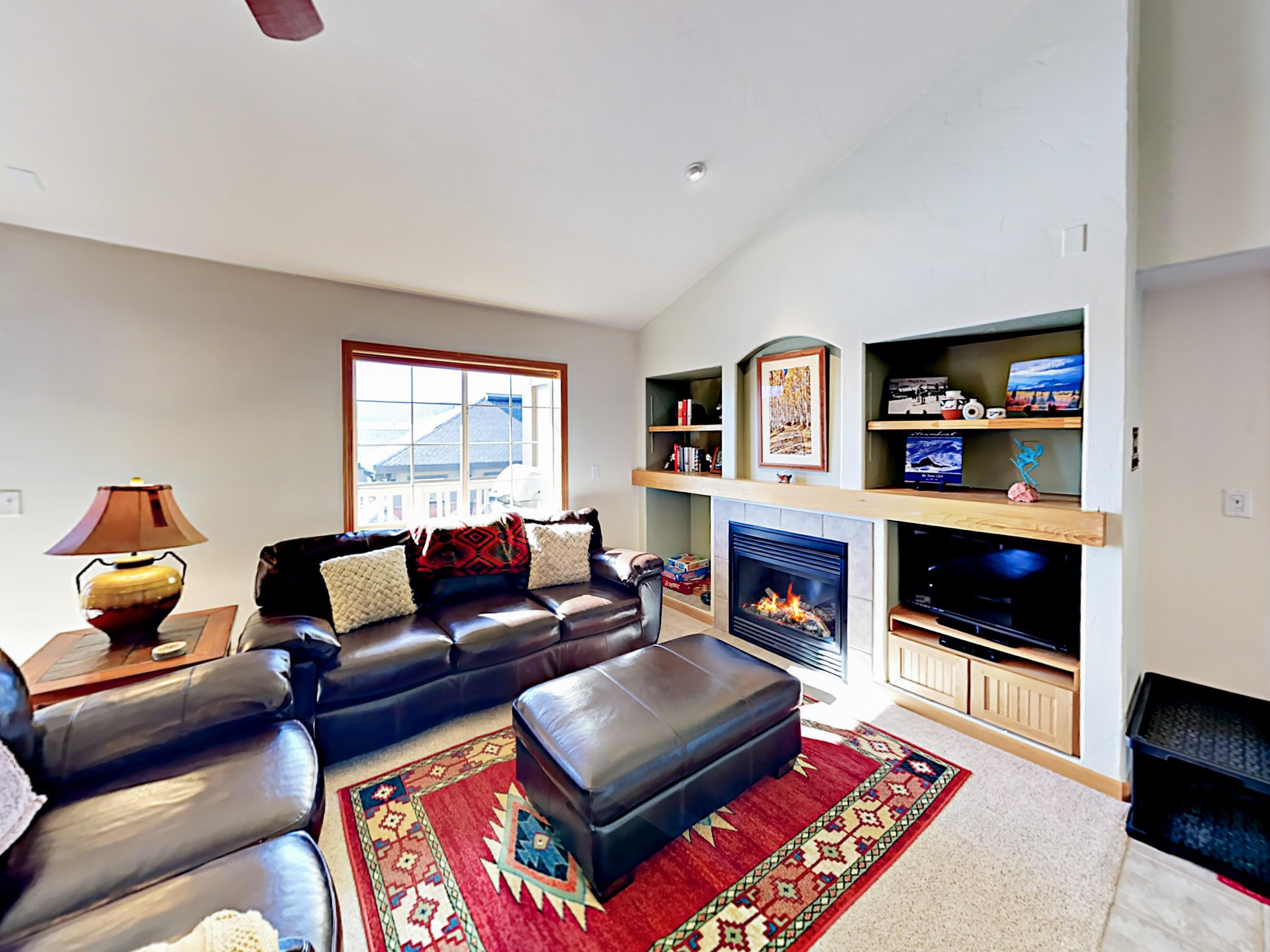 "A sleeper sofa and love seat in the living area surround the gas fireplace and 32"" TV. Complimentary Wi-Fi provided."
