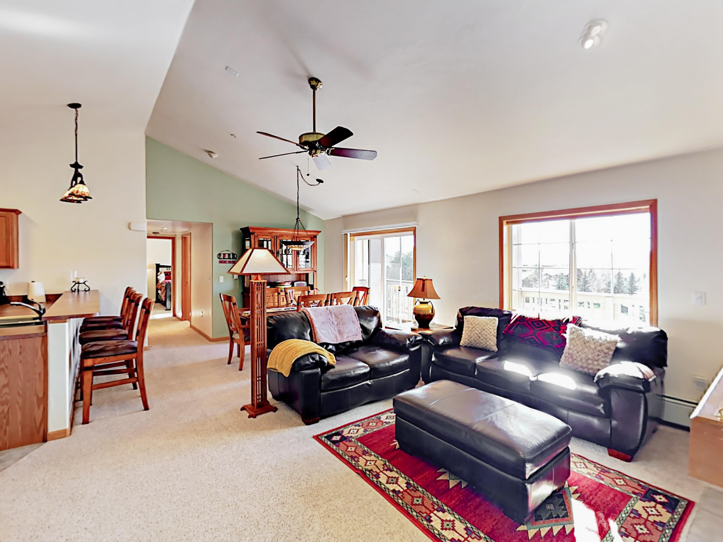 Vaulted ceilings soar in the well-appointed living area.