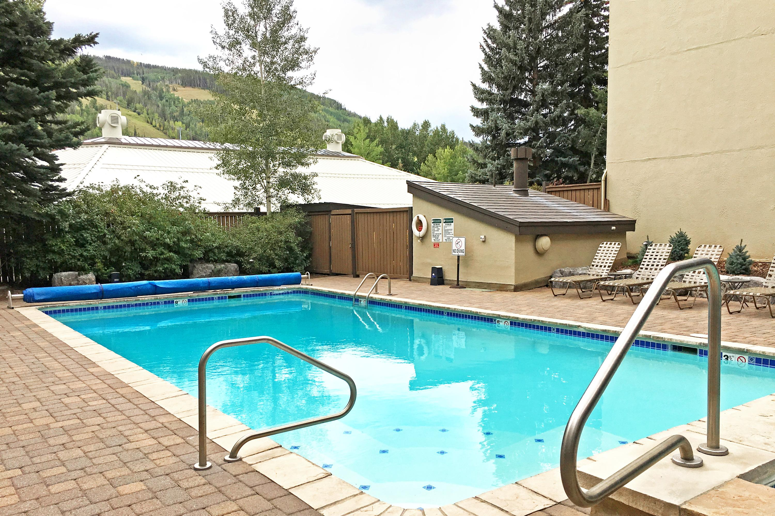 Take a dip in the shared pool with mountain views.