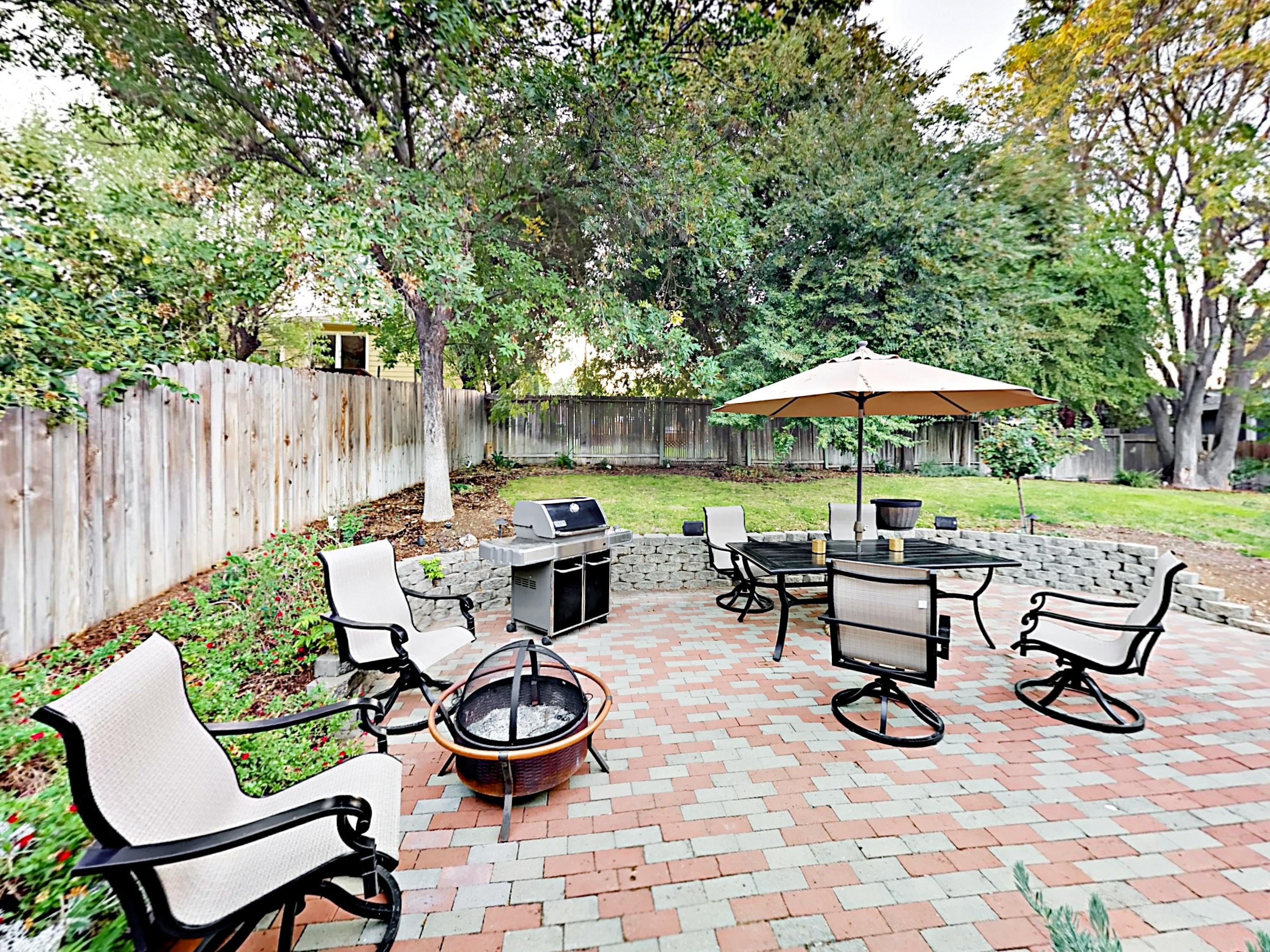 The private patio has ample seating, a gas grill, and a fire pit for s'mores and conversation.