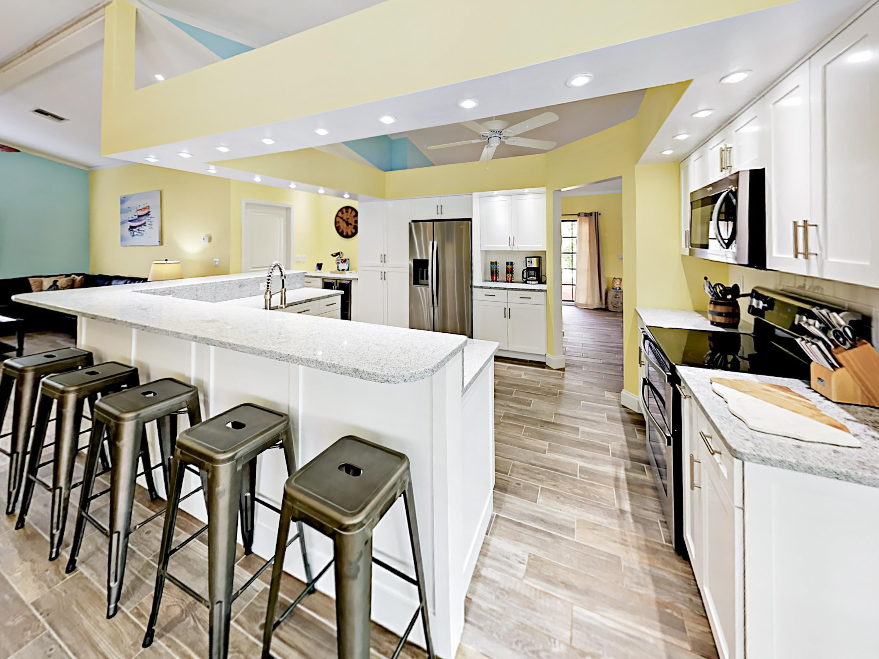 Whip up meals in the kitchen, outfitted with custom granite countertops and stainless steel Whirlpool appliances.