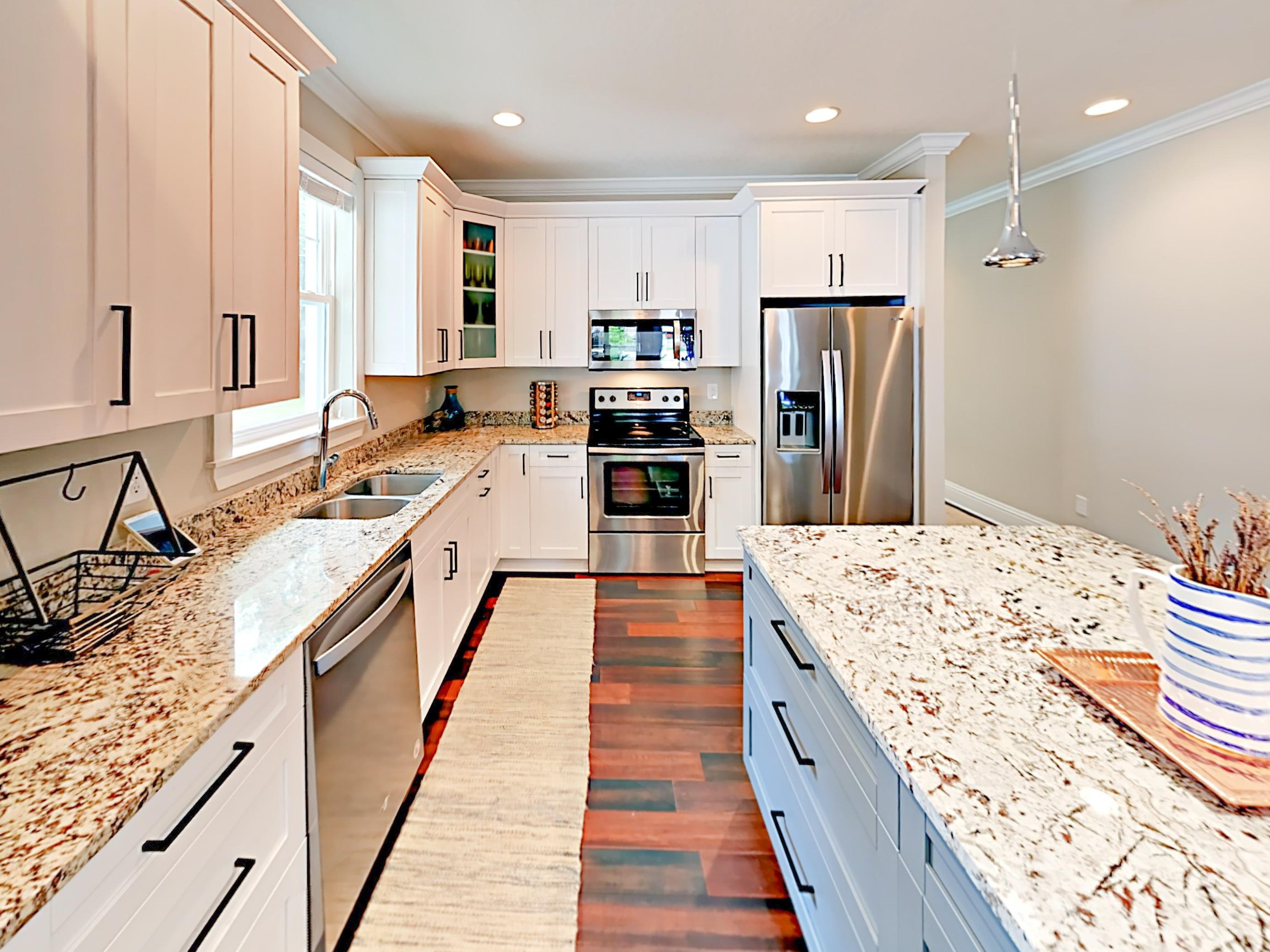 A stainless steel French-door fridge and gleaming granite counters welcome you into the gourmet kitchen.