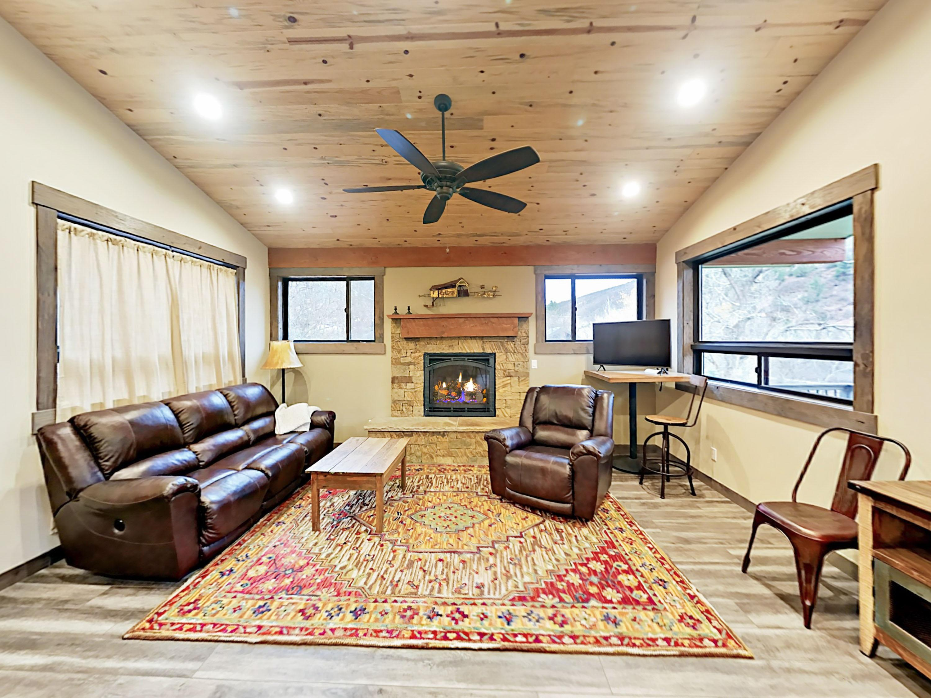 Welcome to Carbondale! Your rental is professionally managed by TurnKey Vacation Rentals. Make yourself at home in the living room, outfitted with a leather couch and an armchair around the fireplace.