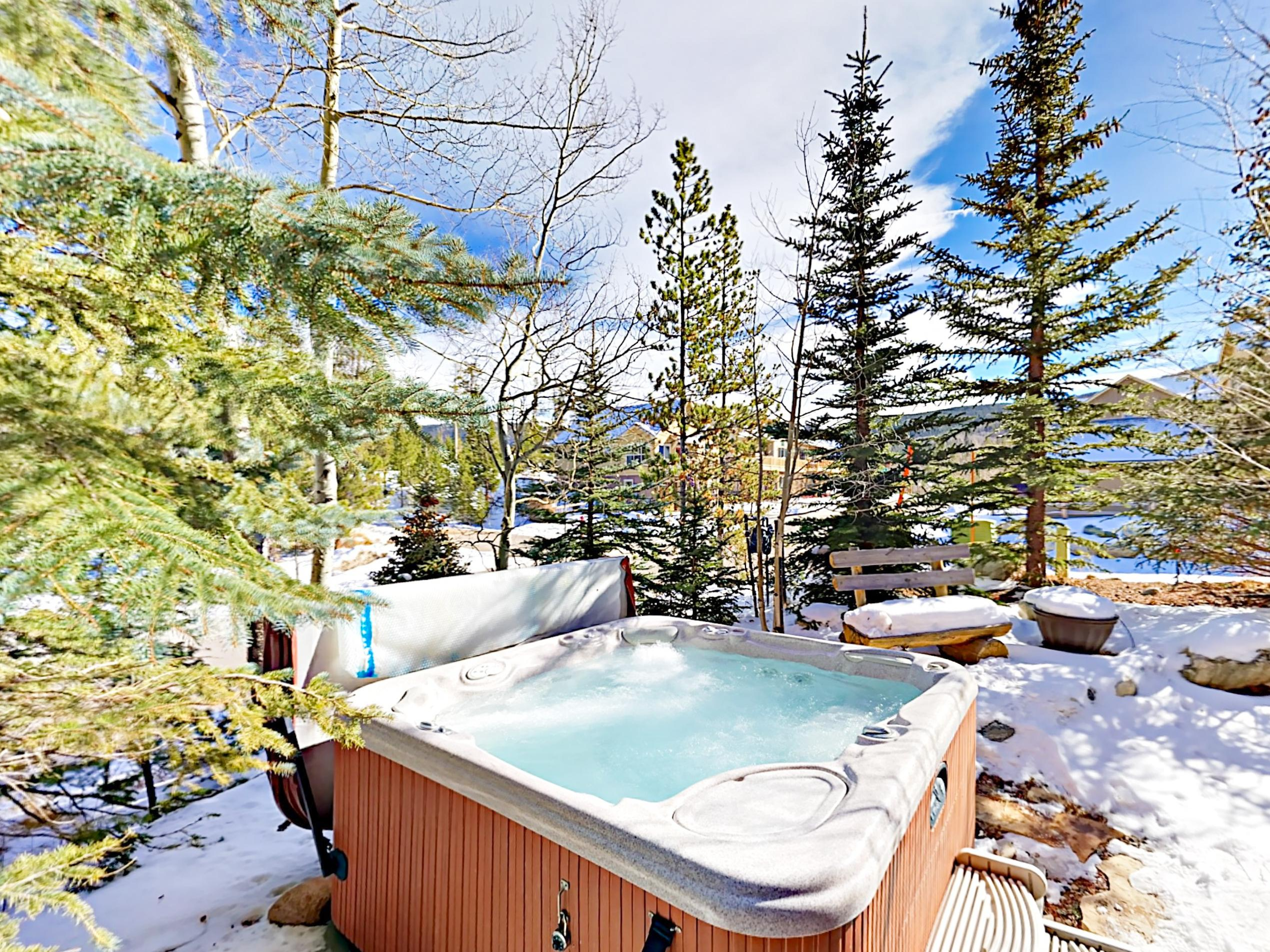 Enjoy a rejuvenating soak in the private hot tub after a day on the slopes.