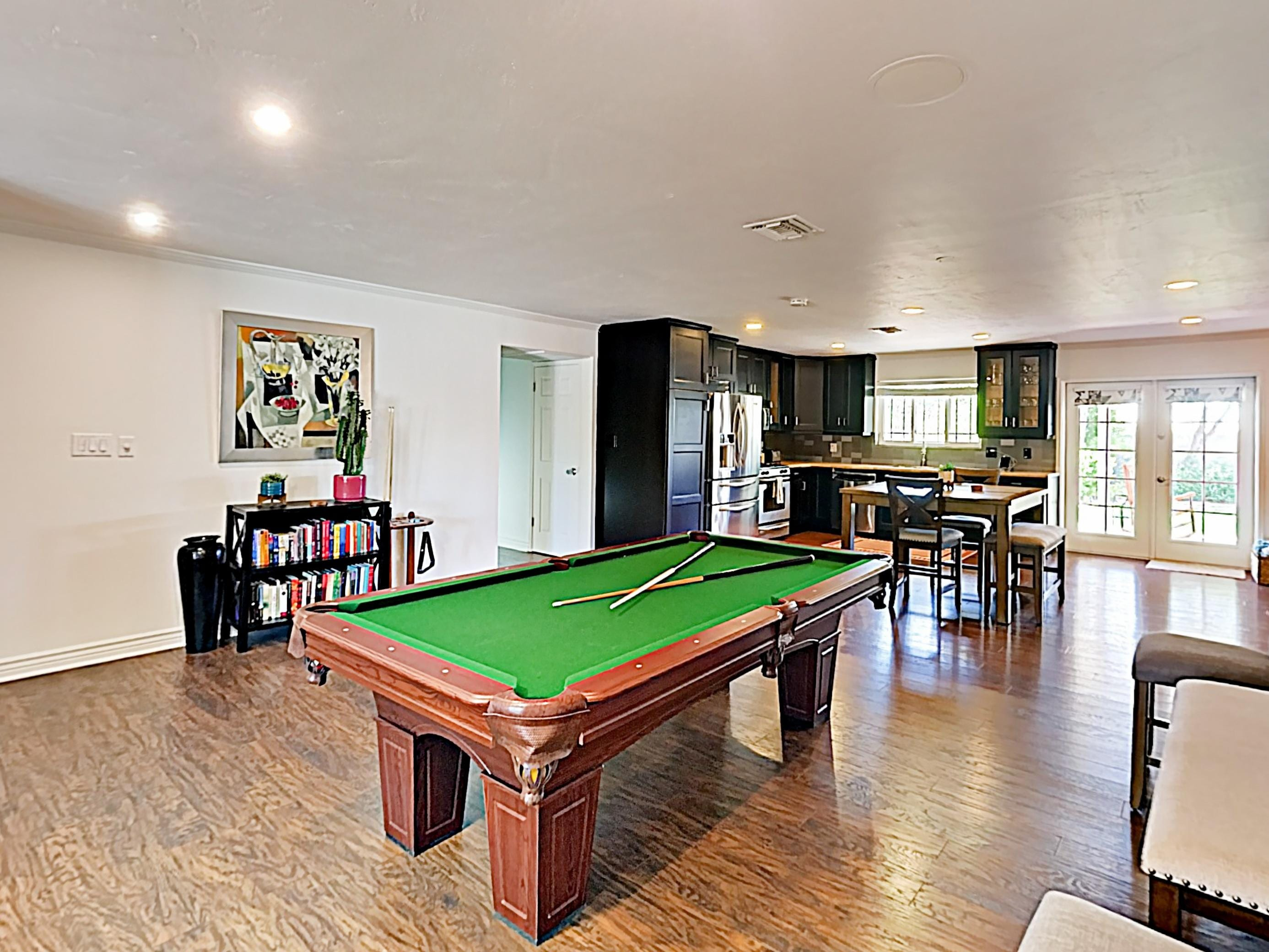 Play a round of billiards at the pool table in the game room.