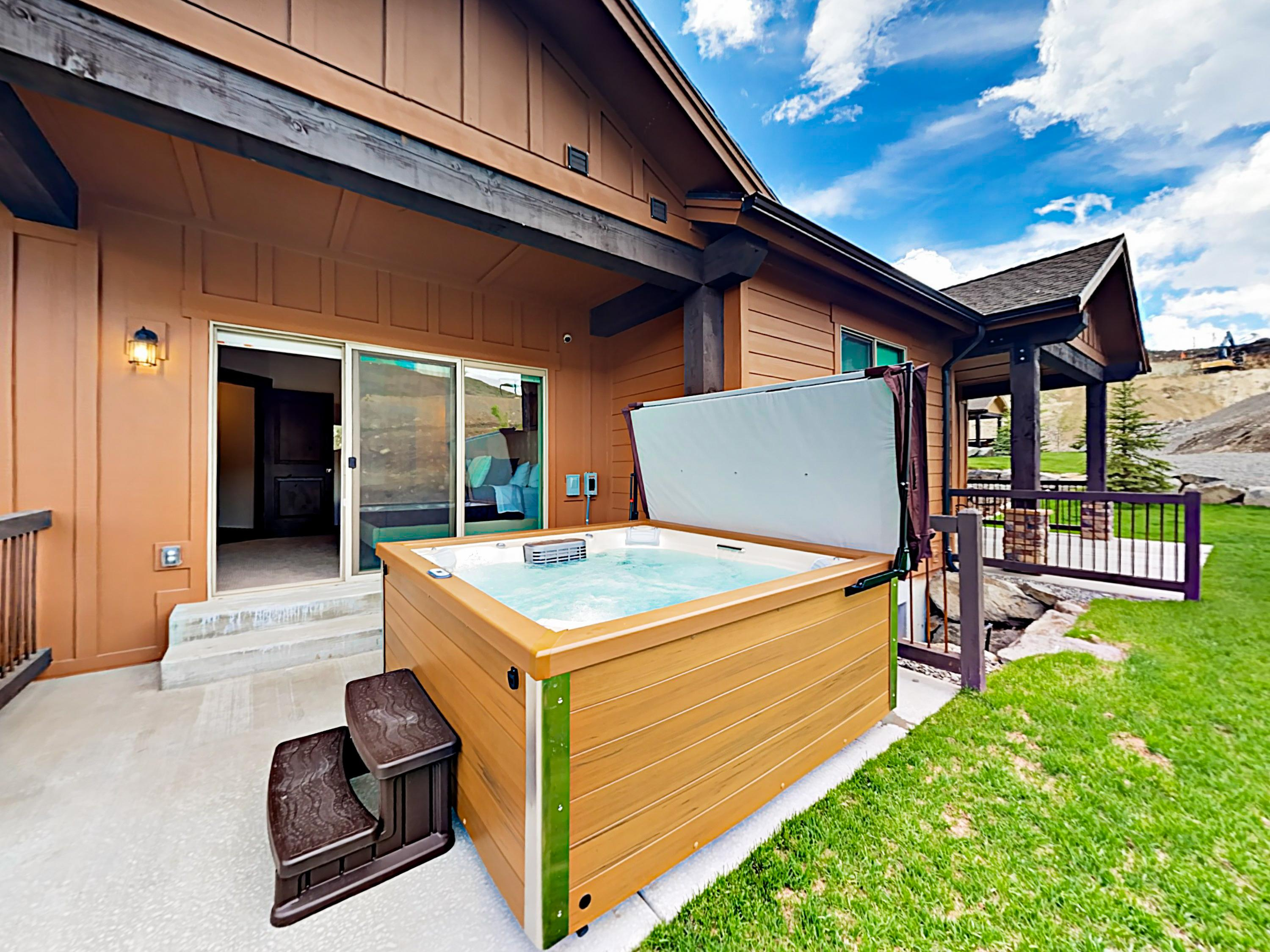Enjoy a relaxing dip in the hot tub located on the back porch.