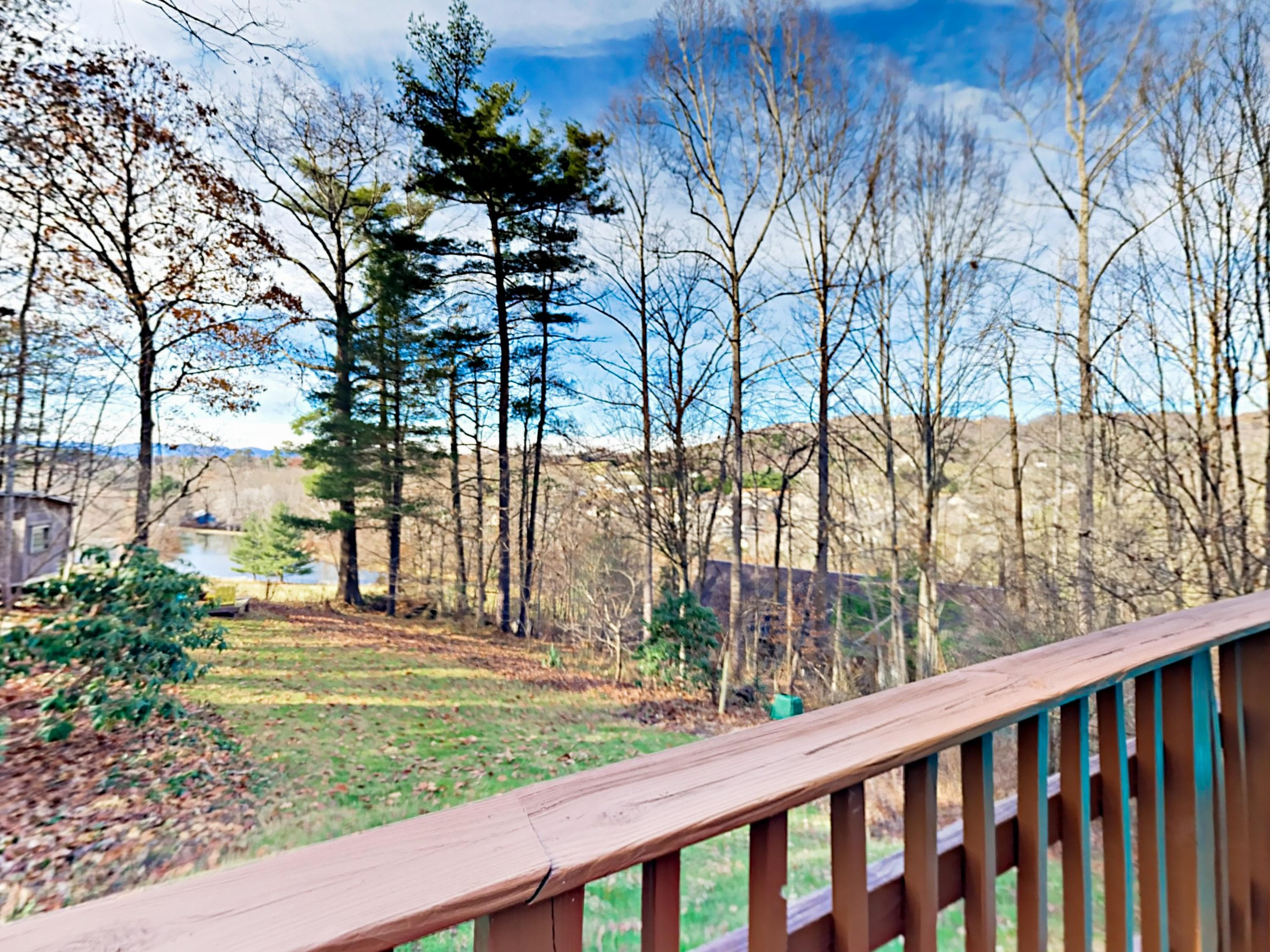 Tranquility awaits with wooded and creek views from the home's private deck.
