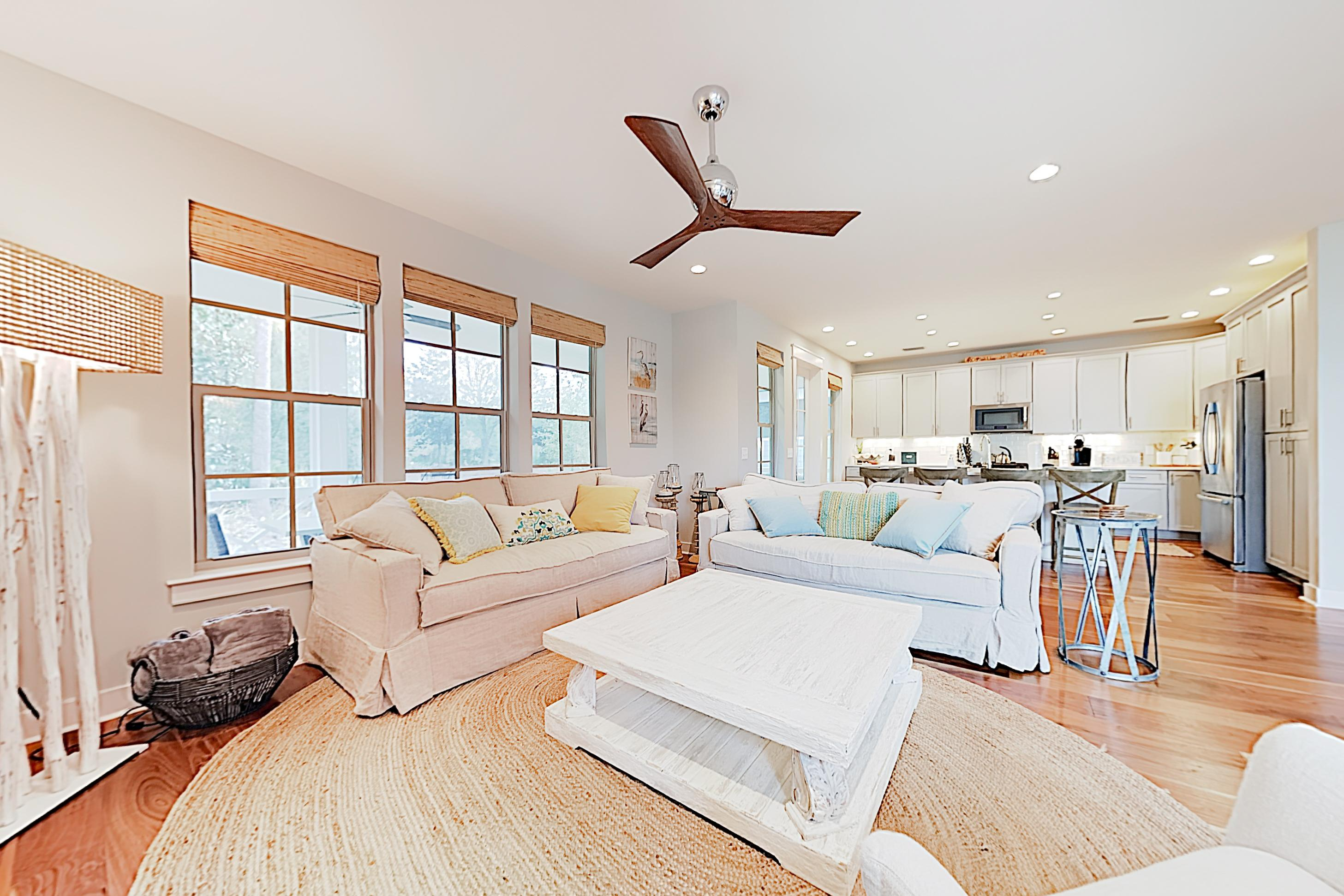 An open concept with hardwood floors creates a bright, airy space.