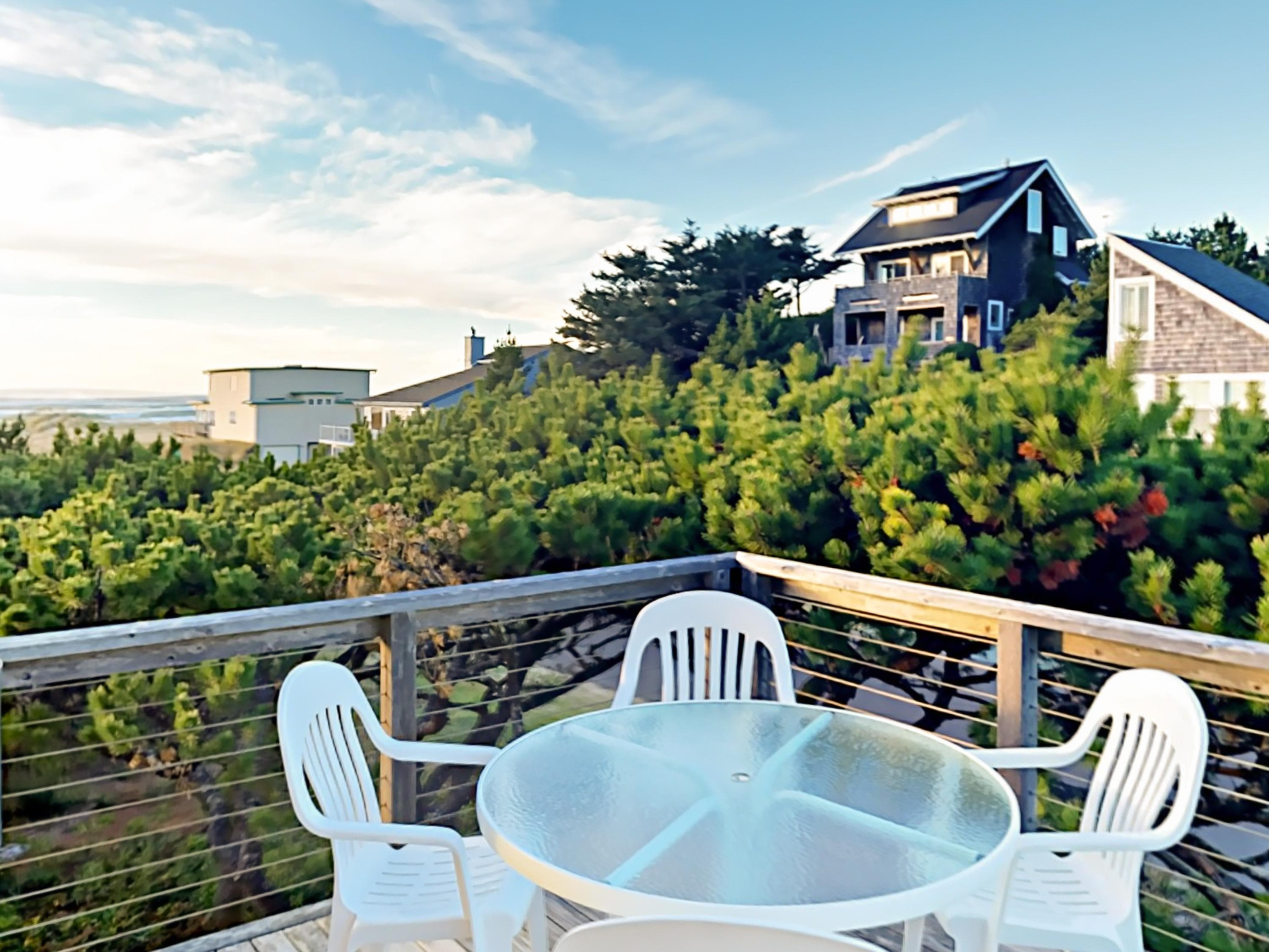 Breathe the fresh coastal air on the spacious balcony with fantastic ocean views.