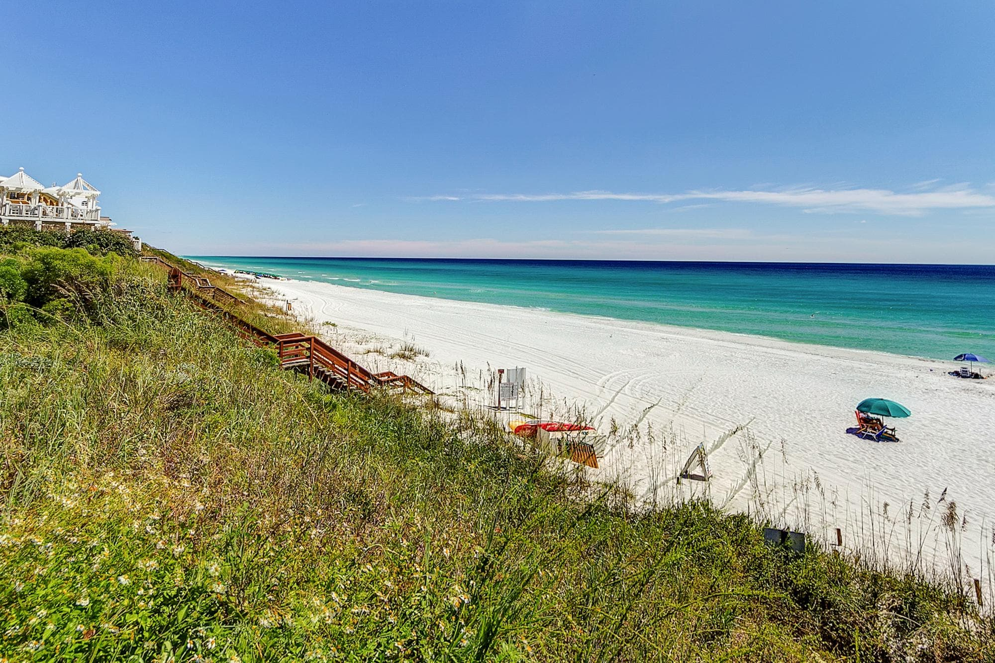 A wooden staircase from the condo complex leads to the beach and the glittering Gulf of Mexico.