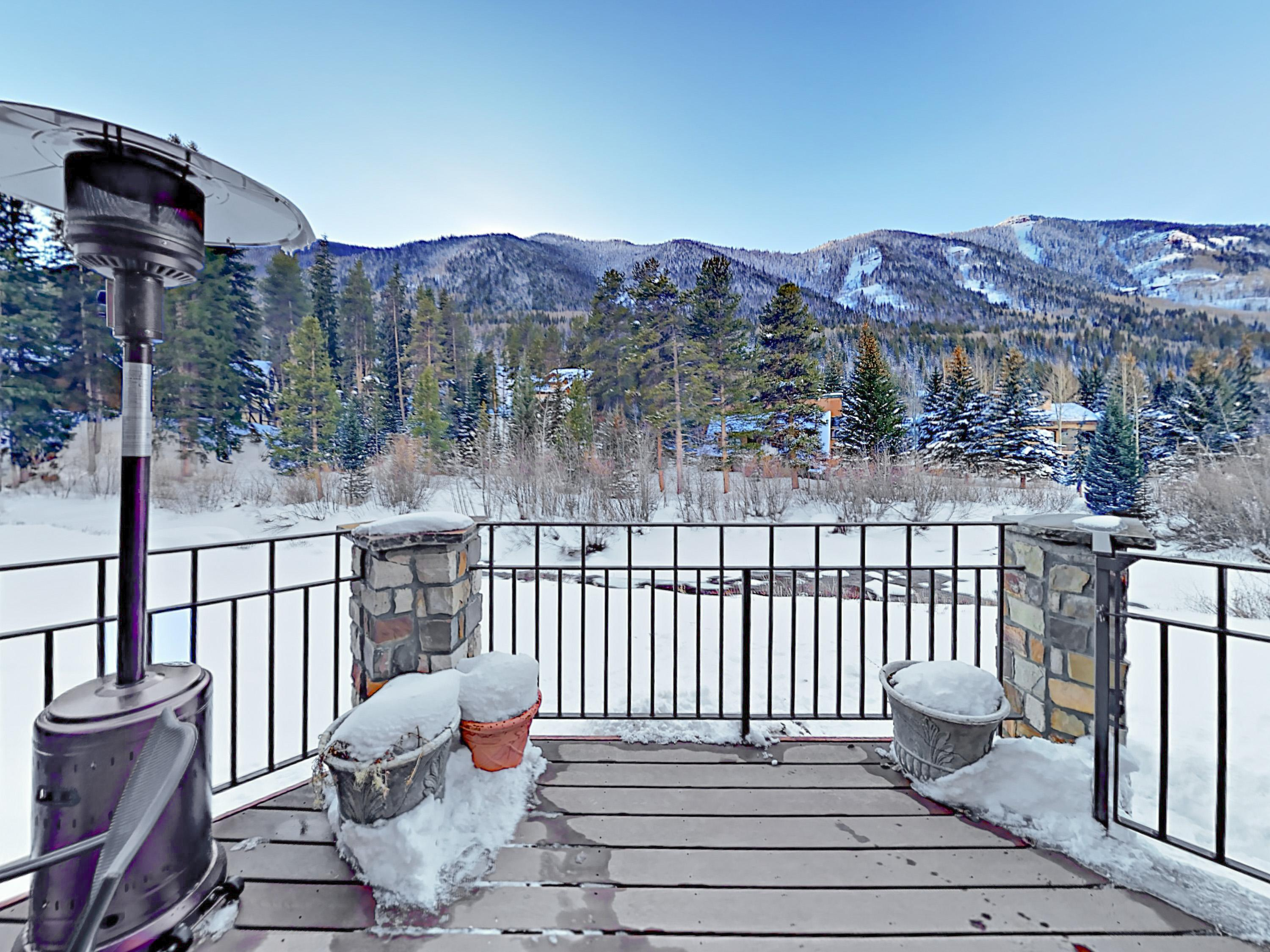 Take in gorgeous mountain views from the private riverfront deck.