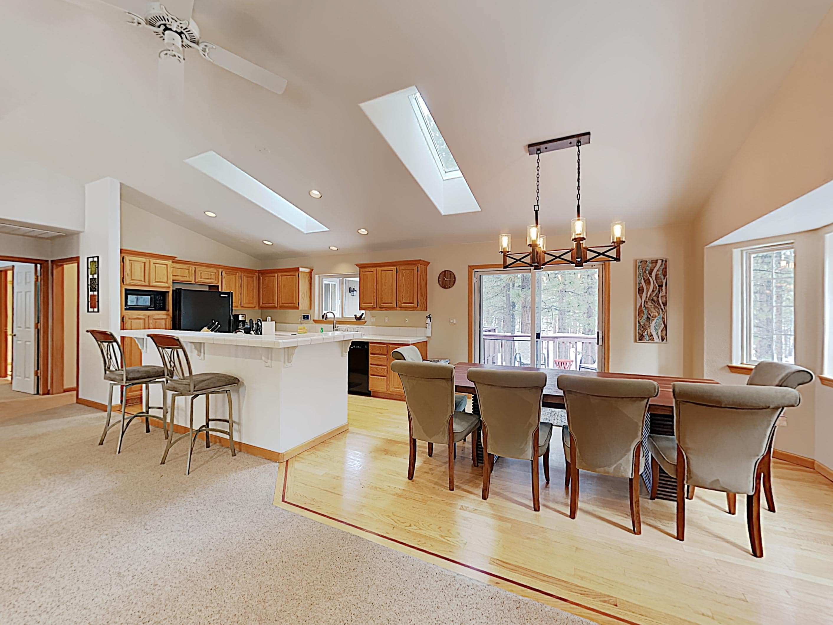 ,The open kitchen and dining space offers a great flow for entertaining.