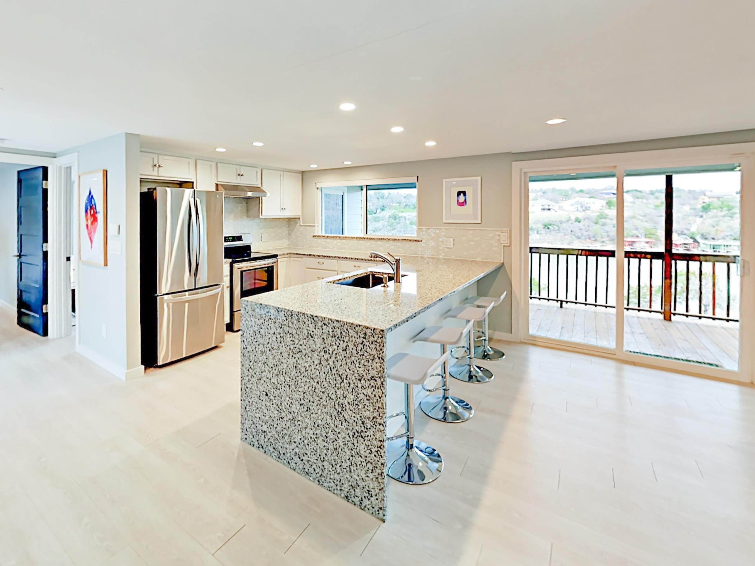 Whip up dinner in the gourmet kitchen, outfitted with sparkling granite countertops and stainless steel appliances.