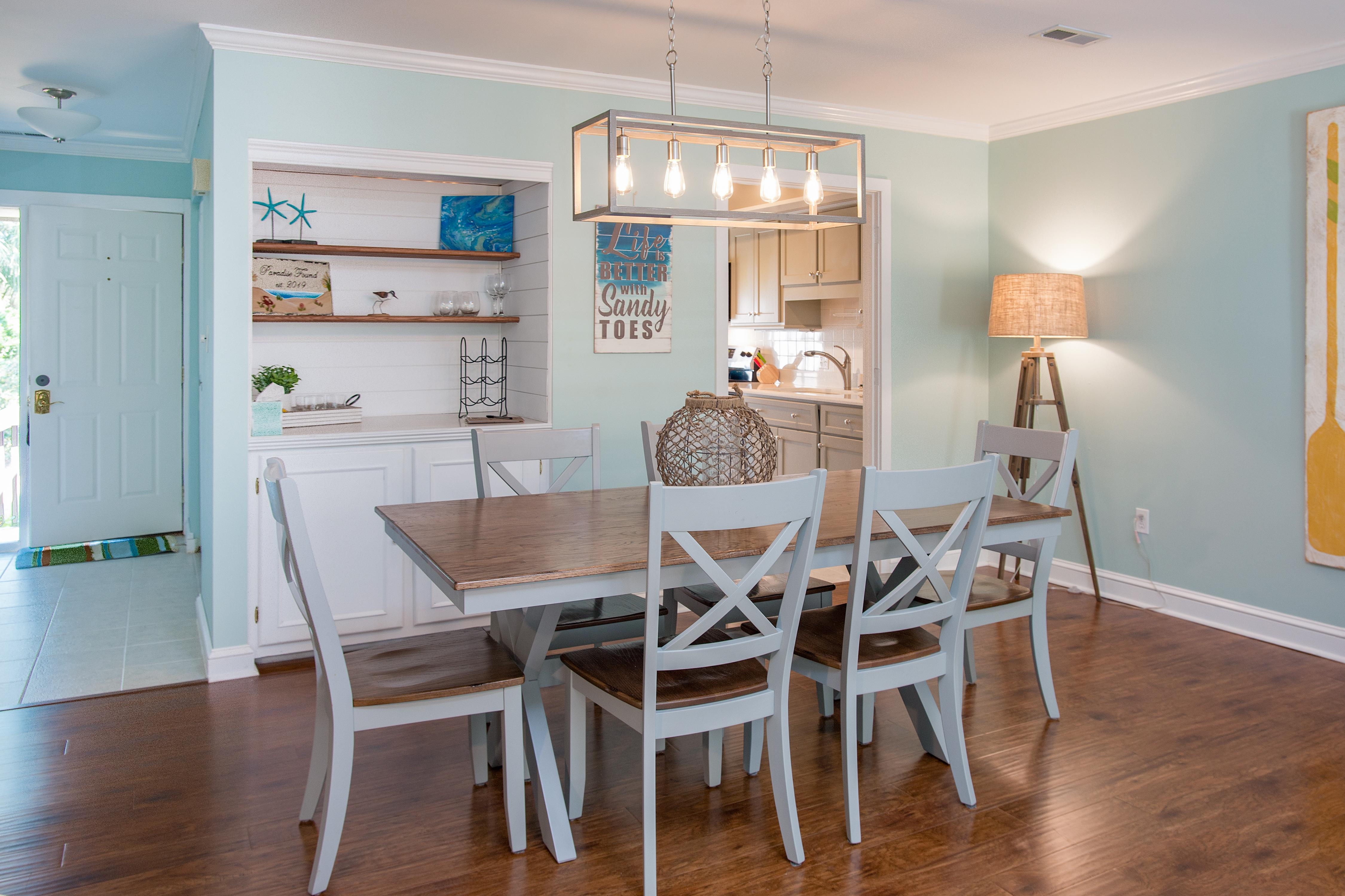 Gather for home-cooked meals at the dining table that seats 6.