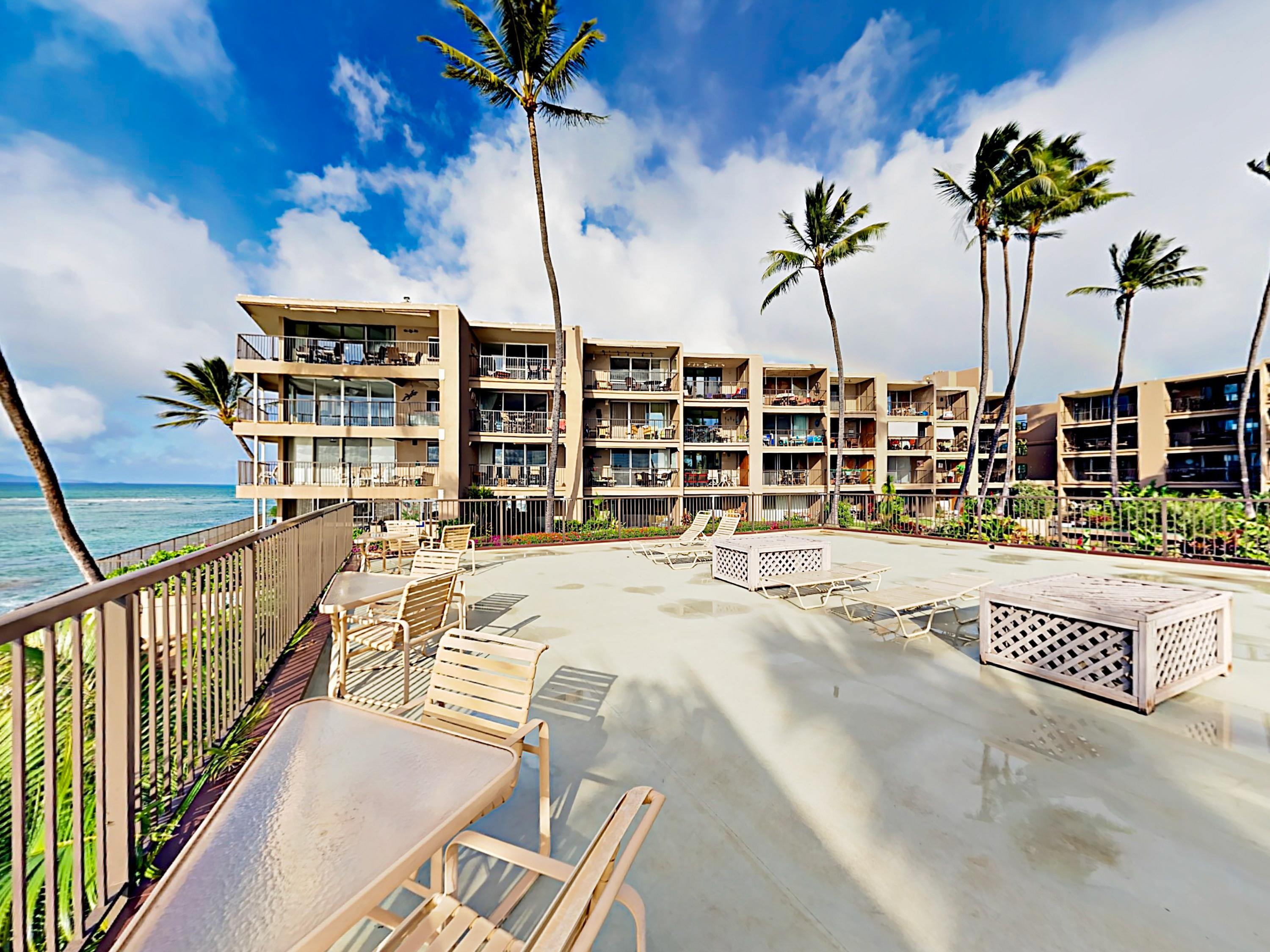 The complex's elevated sundeck overlooks the surf with a view of Molokai island.