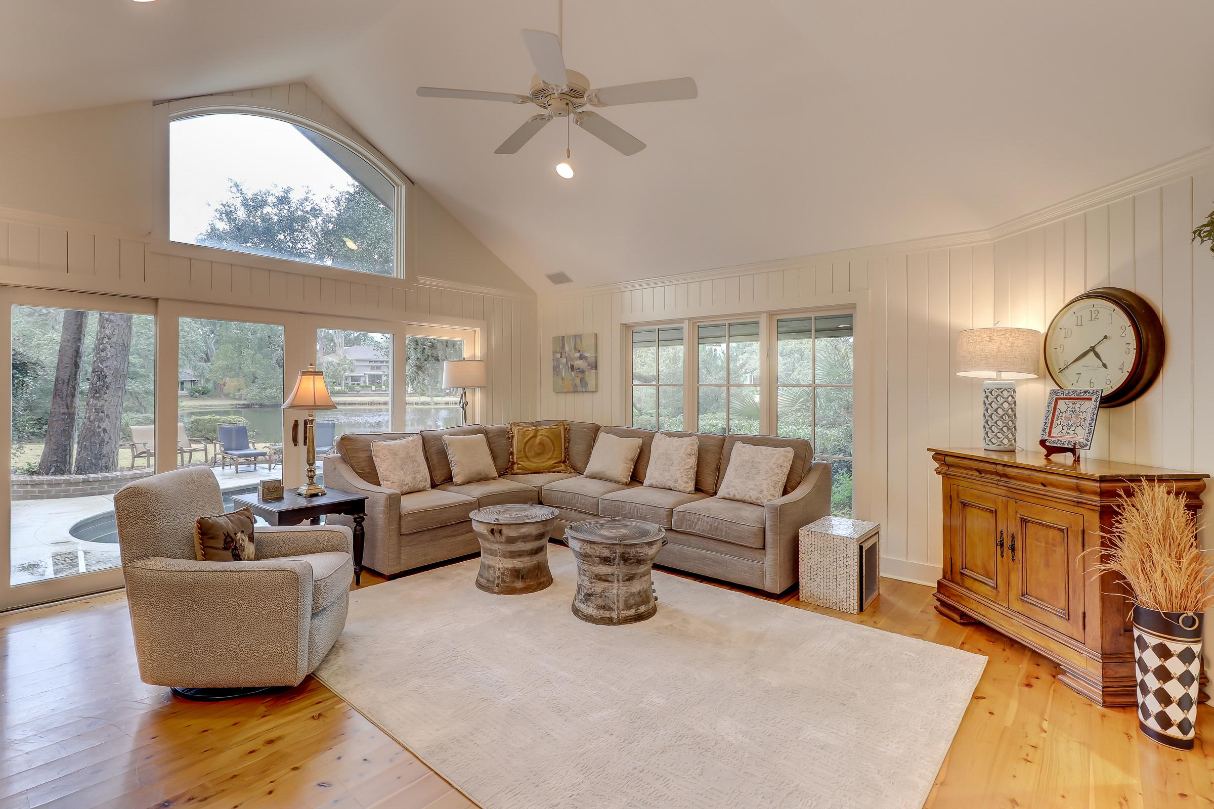 The Great Room boasts vaulted ceilings and tall windows overlooking to outdoor oasis.