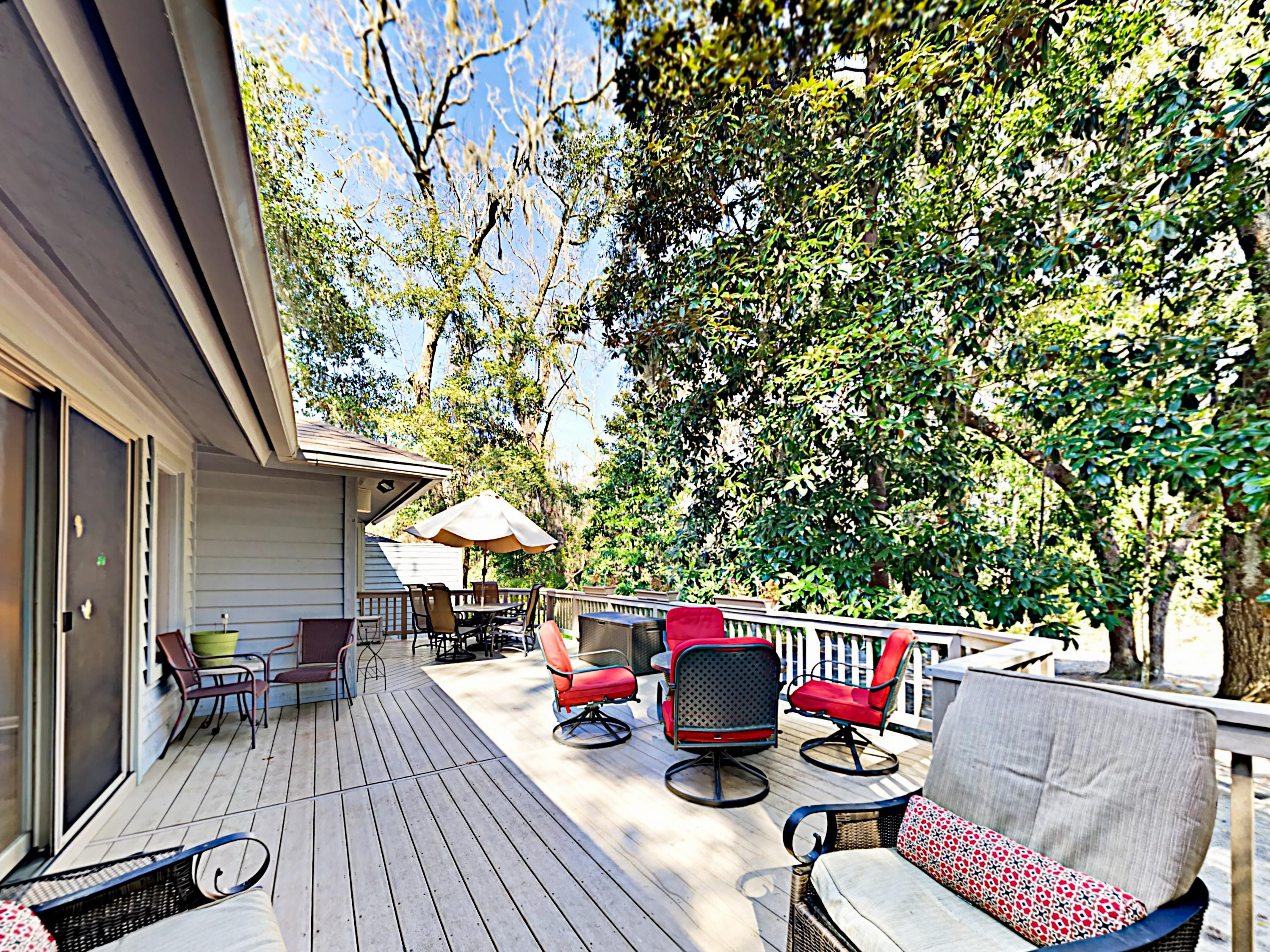 The spacious, tree-lined deck has plenty of seating.