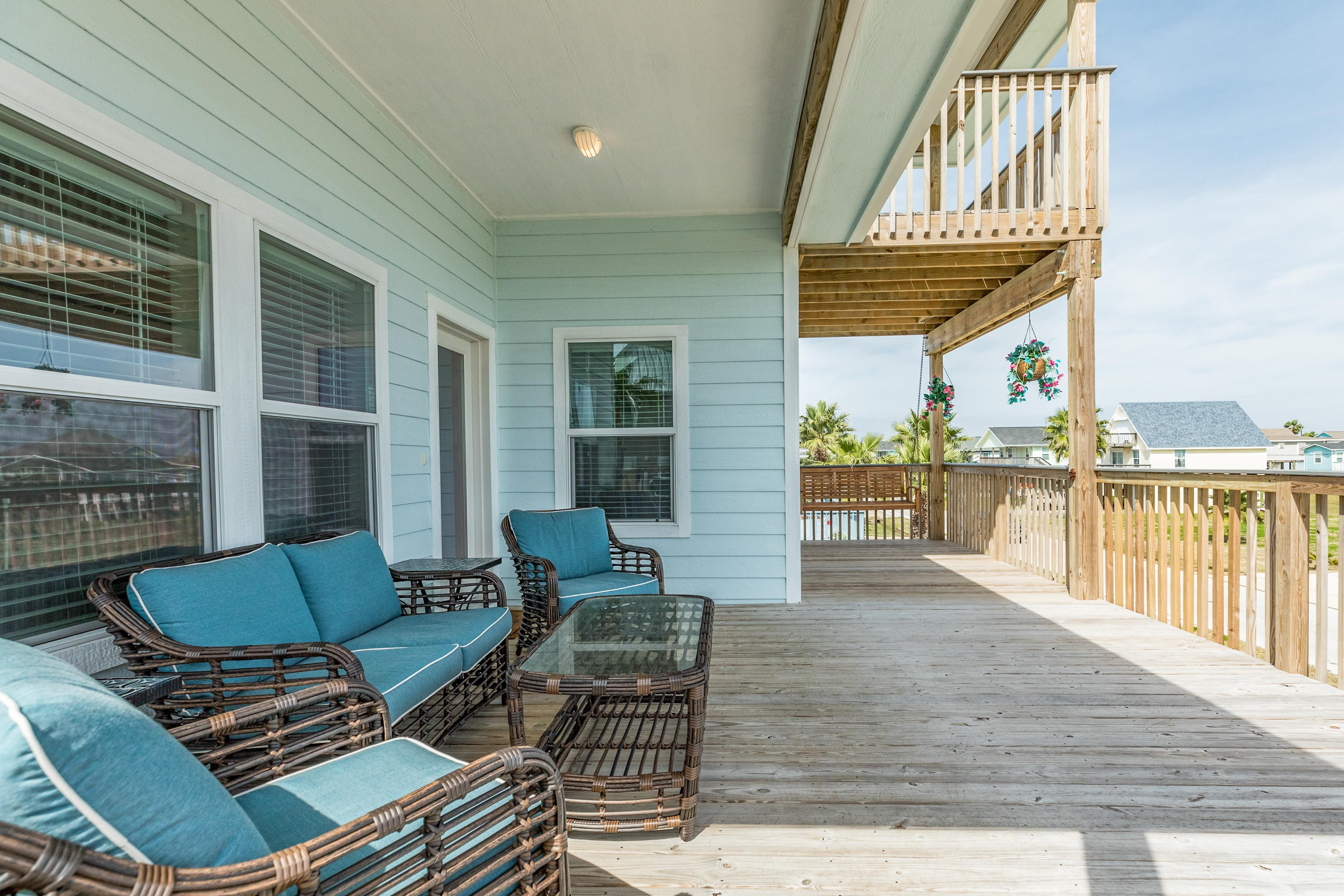 Enjoy the fresh air on an expansive front deck.
