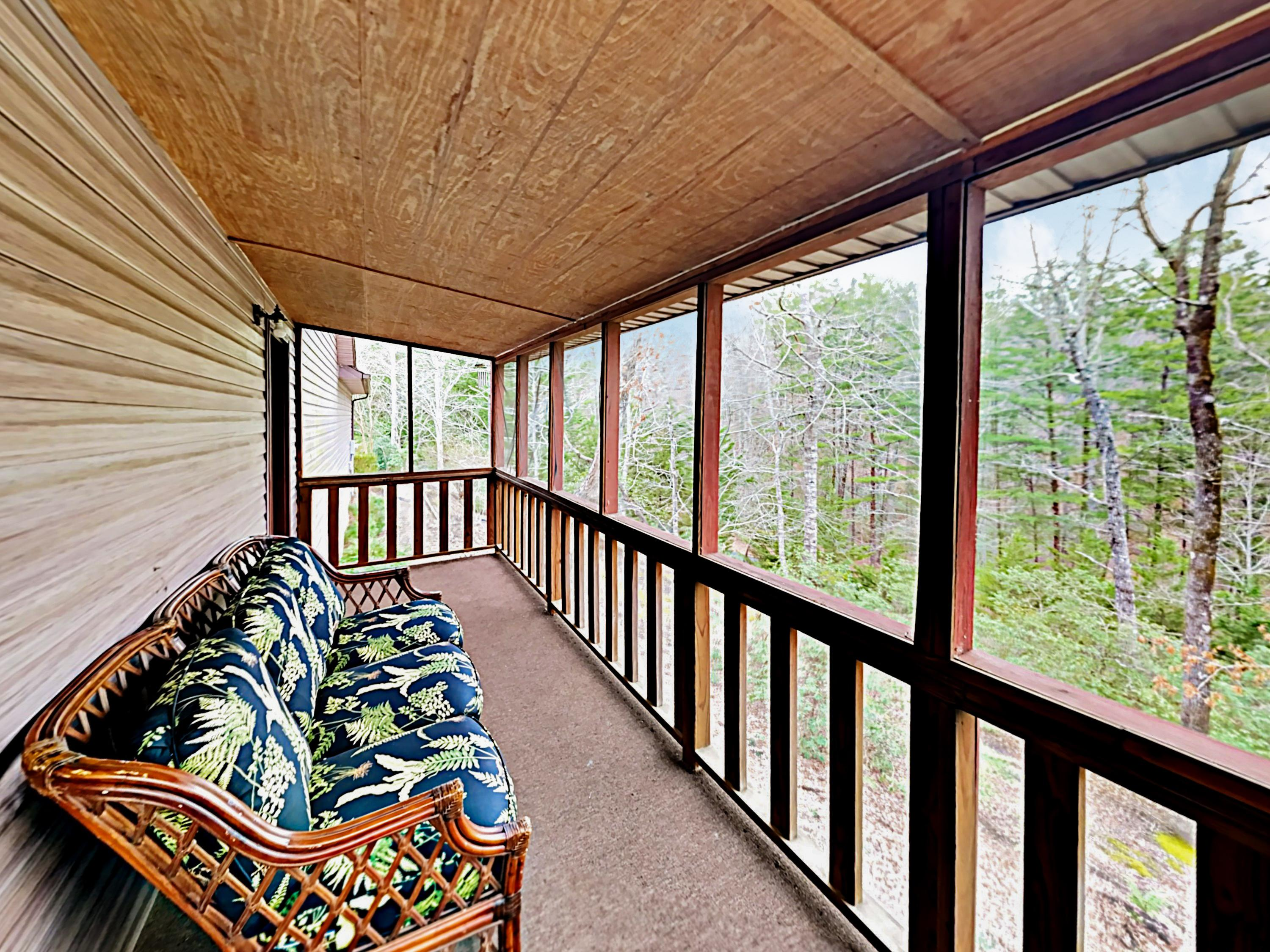 Comfy seating and mountain views await on the wrap-around back deck.