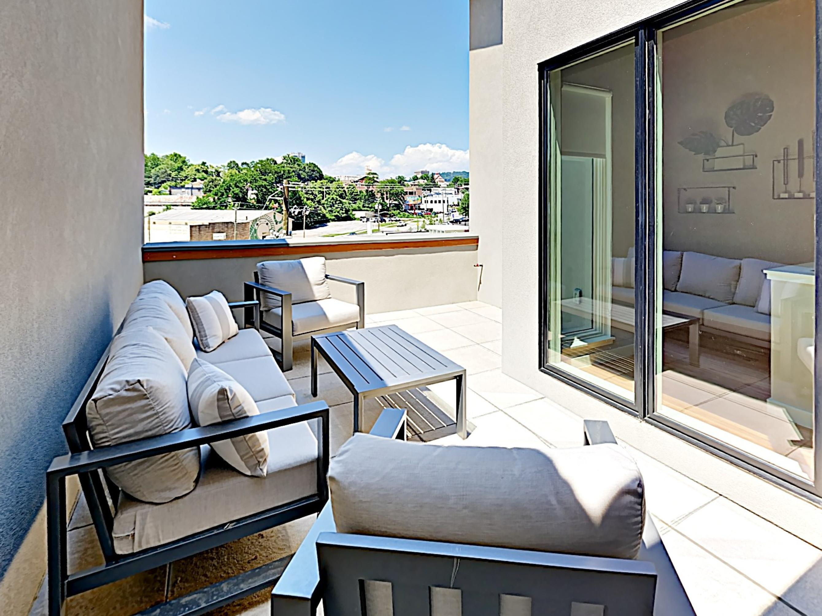 Enjoy views of the city from the top floor balcony.