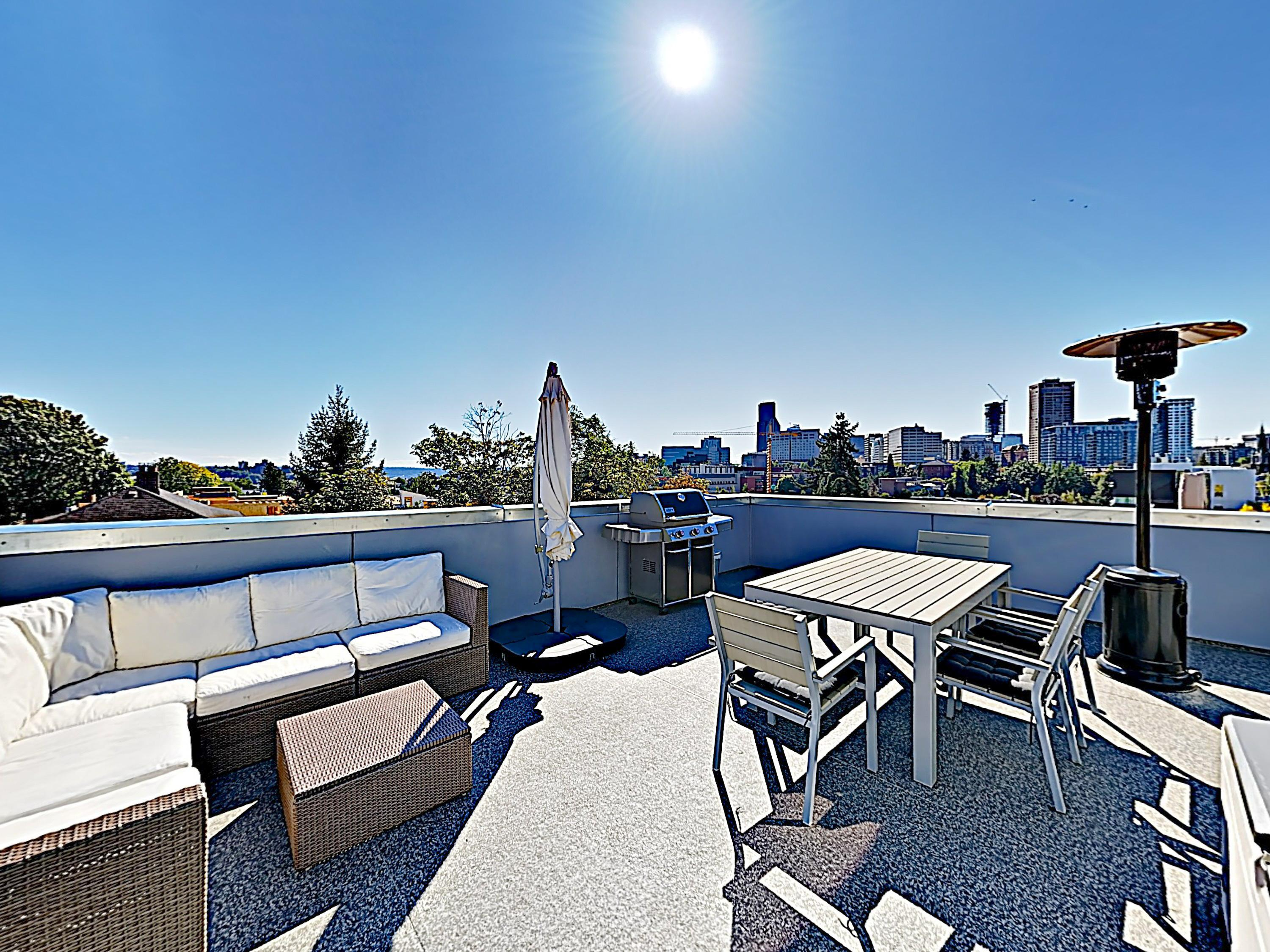 Gather for drinks on the outdoor couch, located on your rooftop deck.