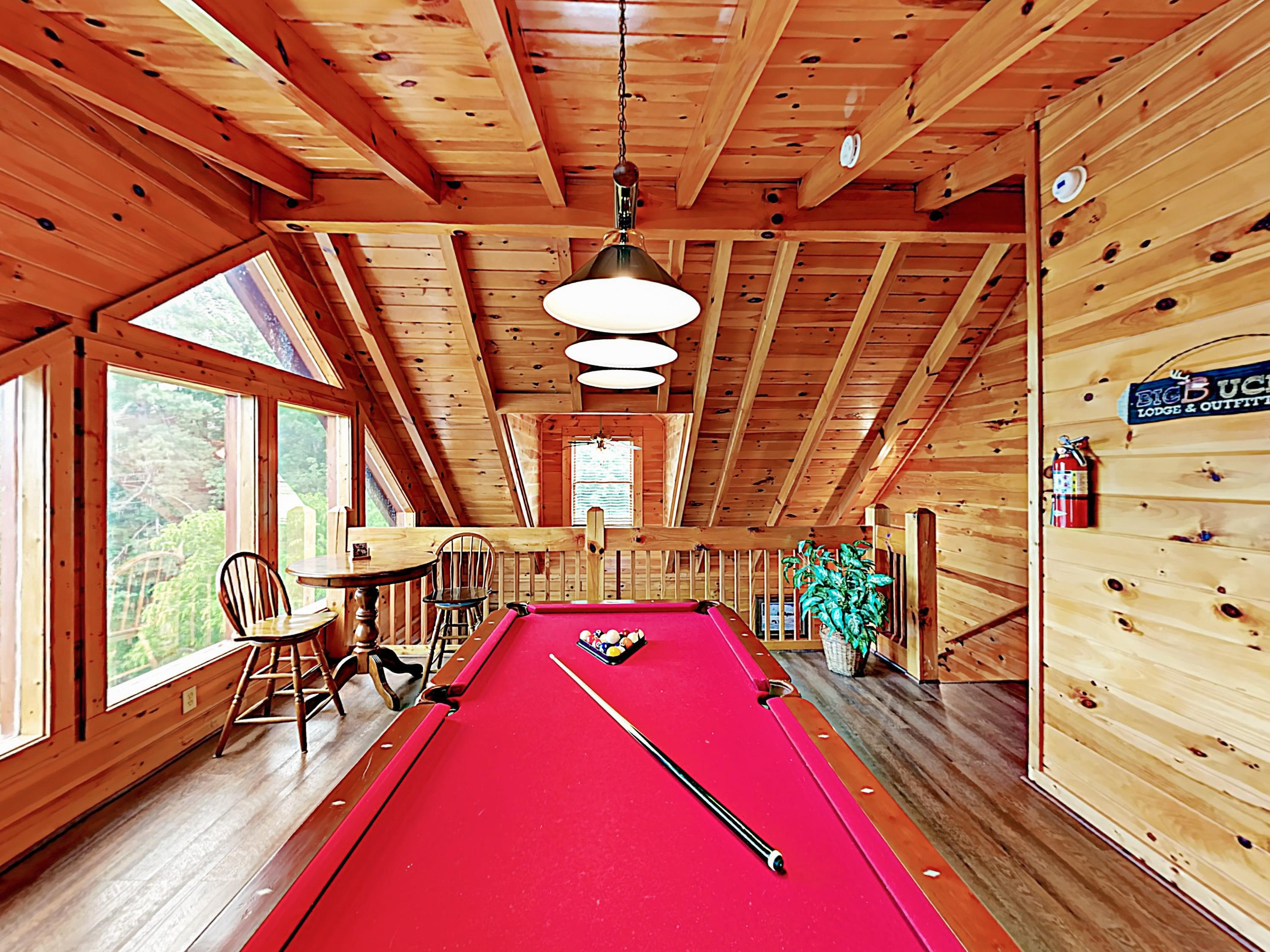 A pool table in the 2nd-floor loft provides hours of family fun.
