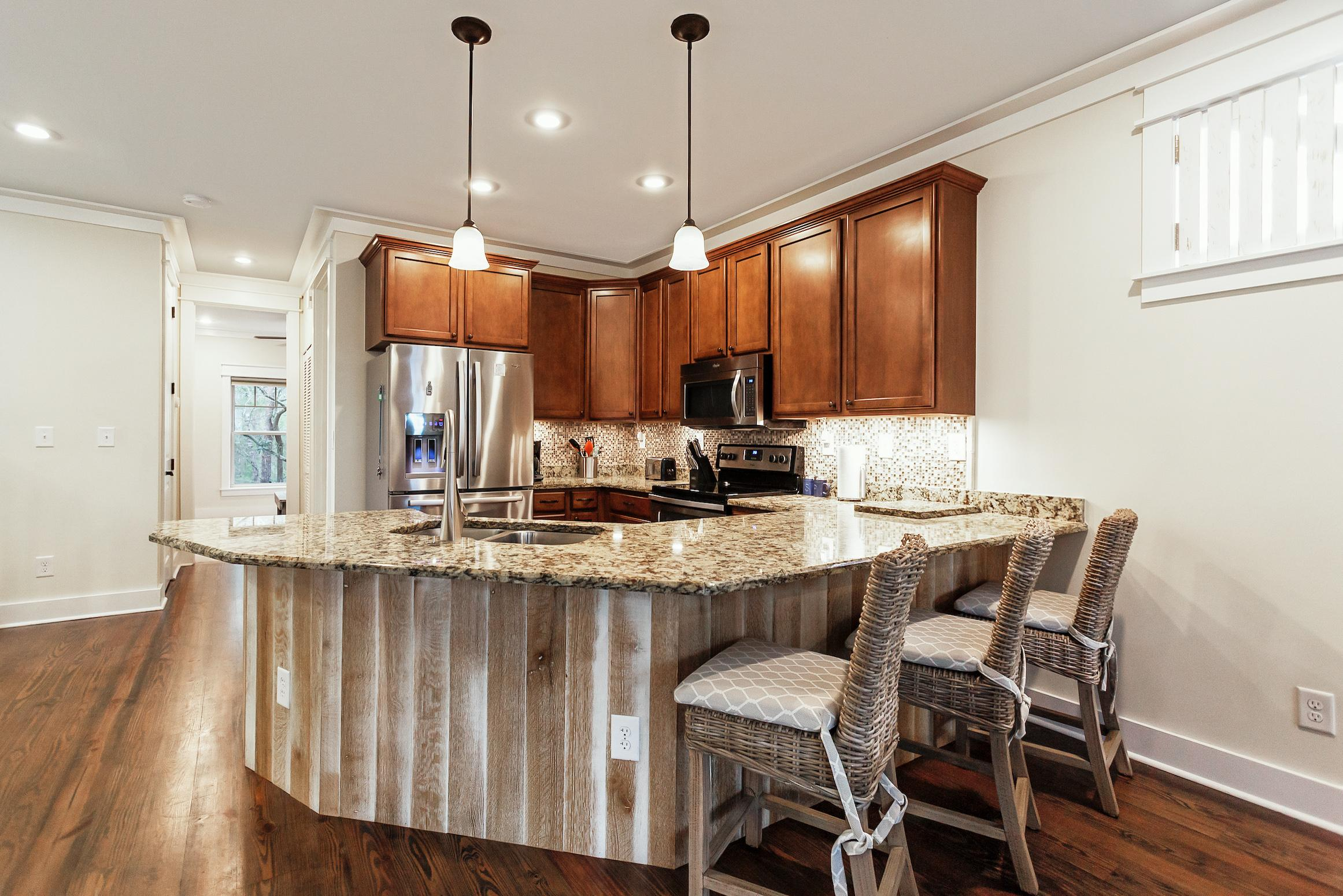Cook up a feast in the gourmet kitchen, outfitted with sparkling granite countertops.