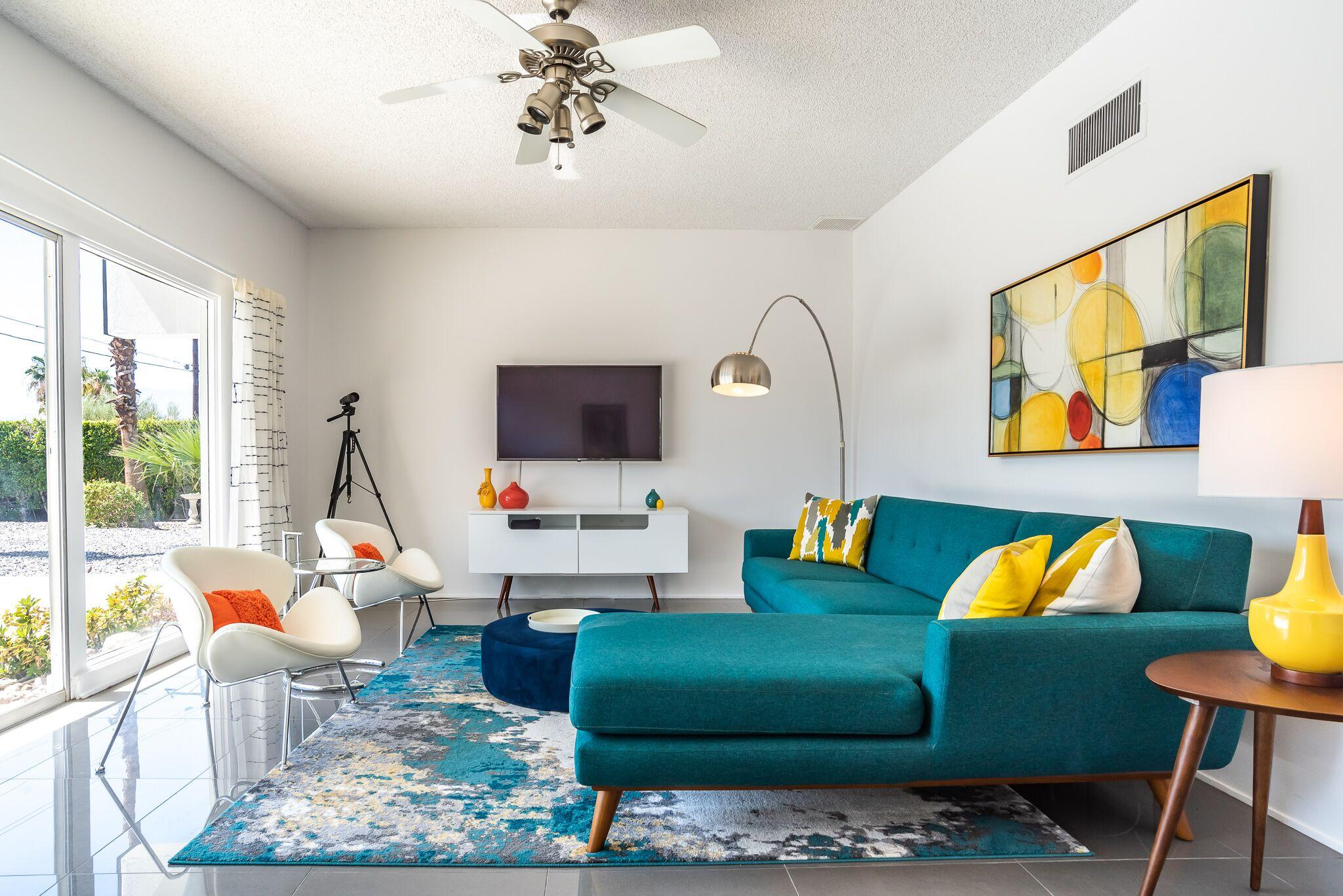 The stylish living room includes a sectional and 2 armchairs.
