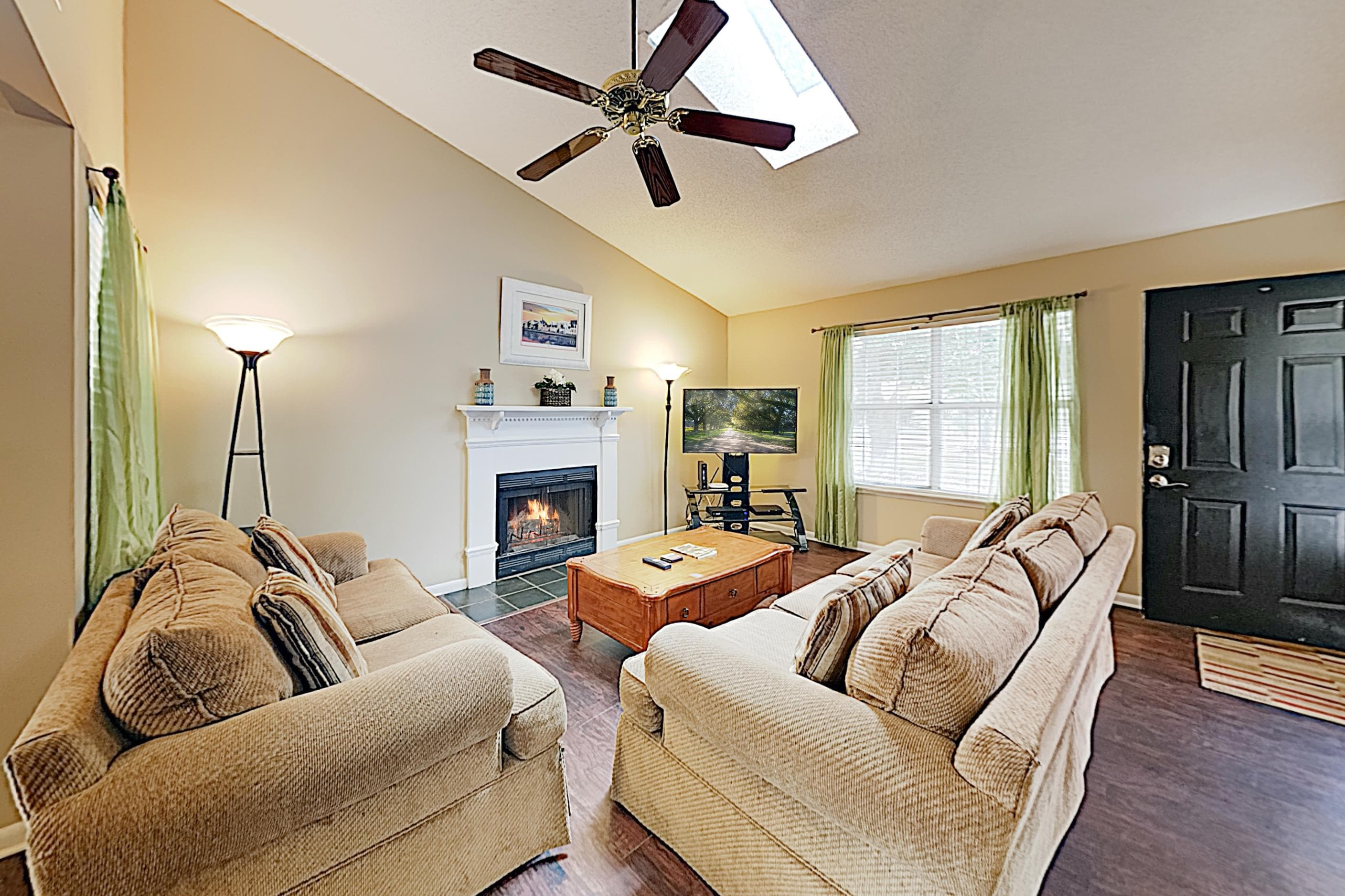 "The living area features a wood-burning fireplace, 50"" cable TV, and a plush sofa and love seat."
