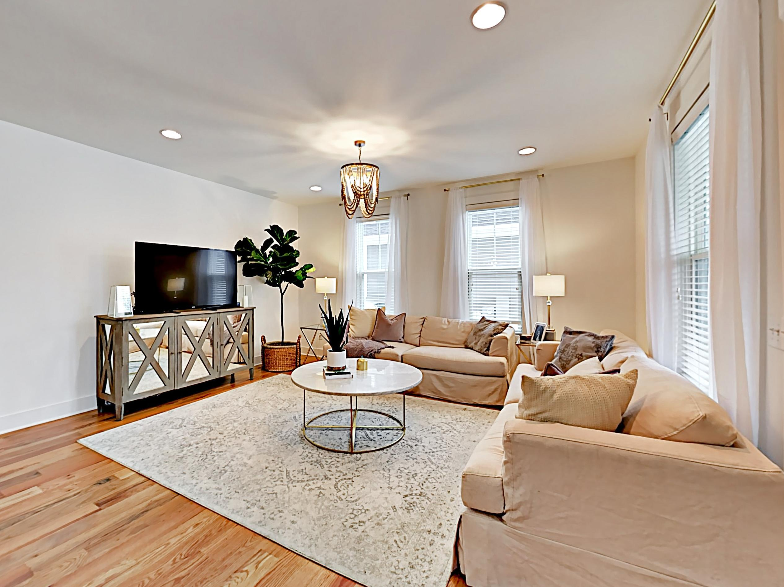 The elegant living room has seating for 6.