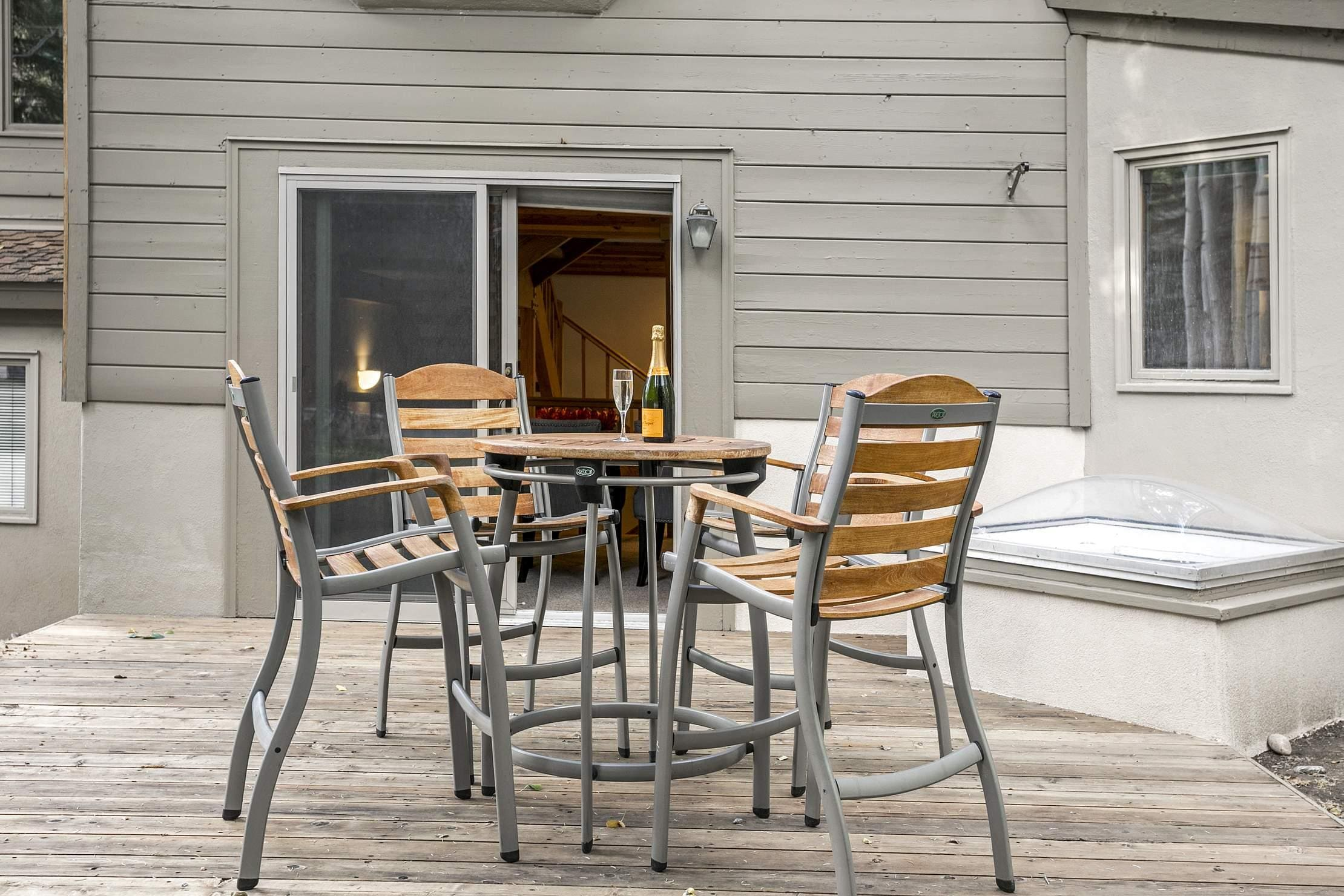 Gather for drinks and conversations at a bistro table on the back deck.