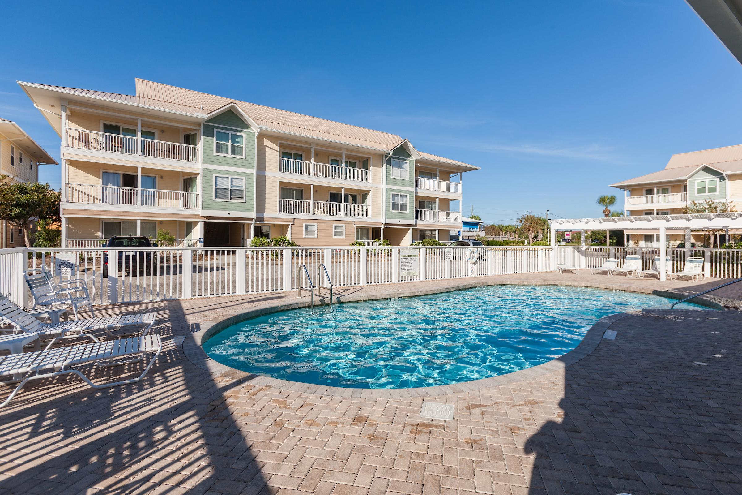 Soak up the sun beside the shared complex pool.
