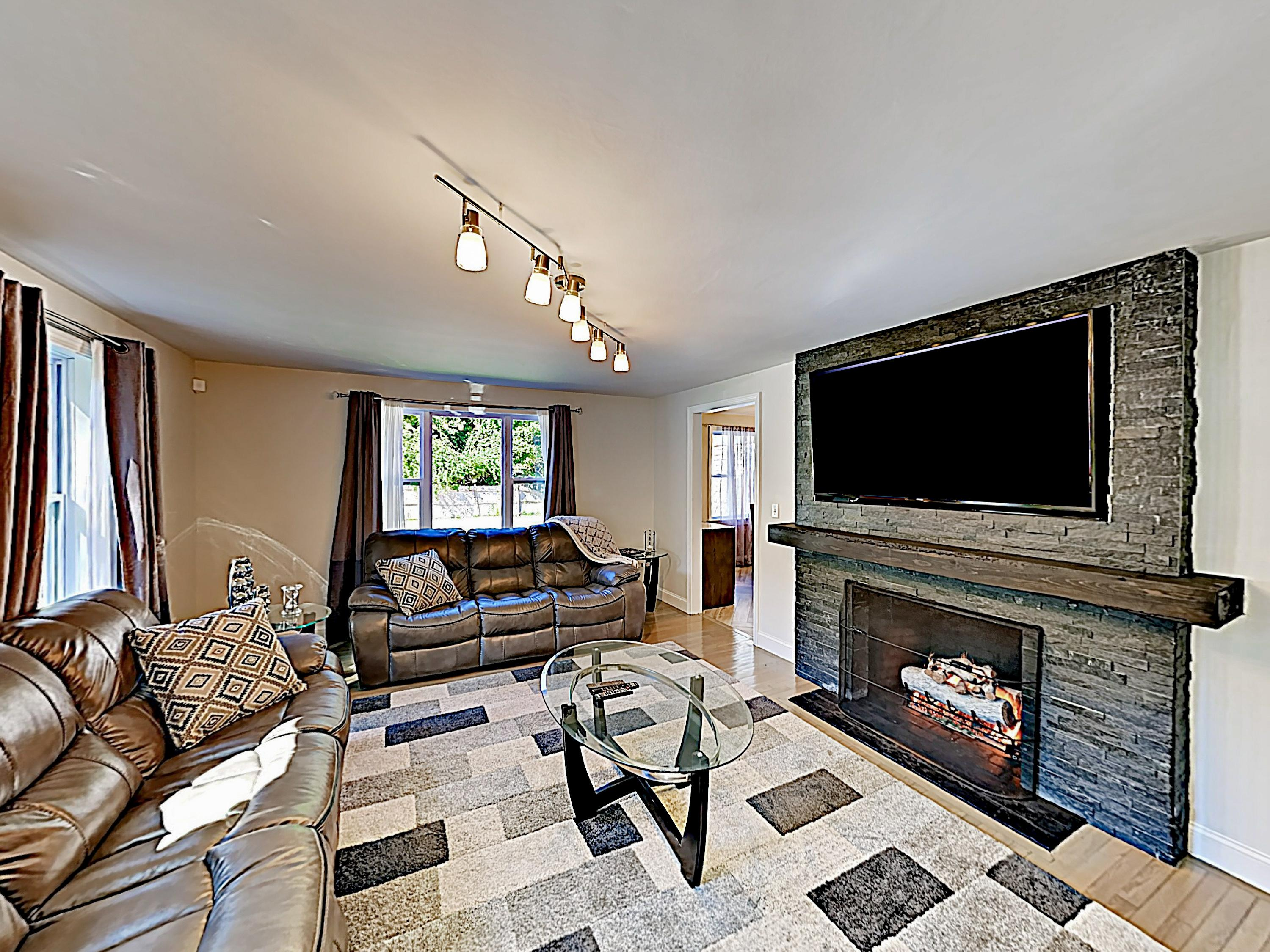 "Enjoy the warm ambience of the gas fireplace while you take in a movie on the 70"" flat-screen TV."