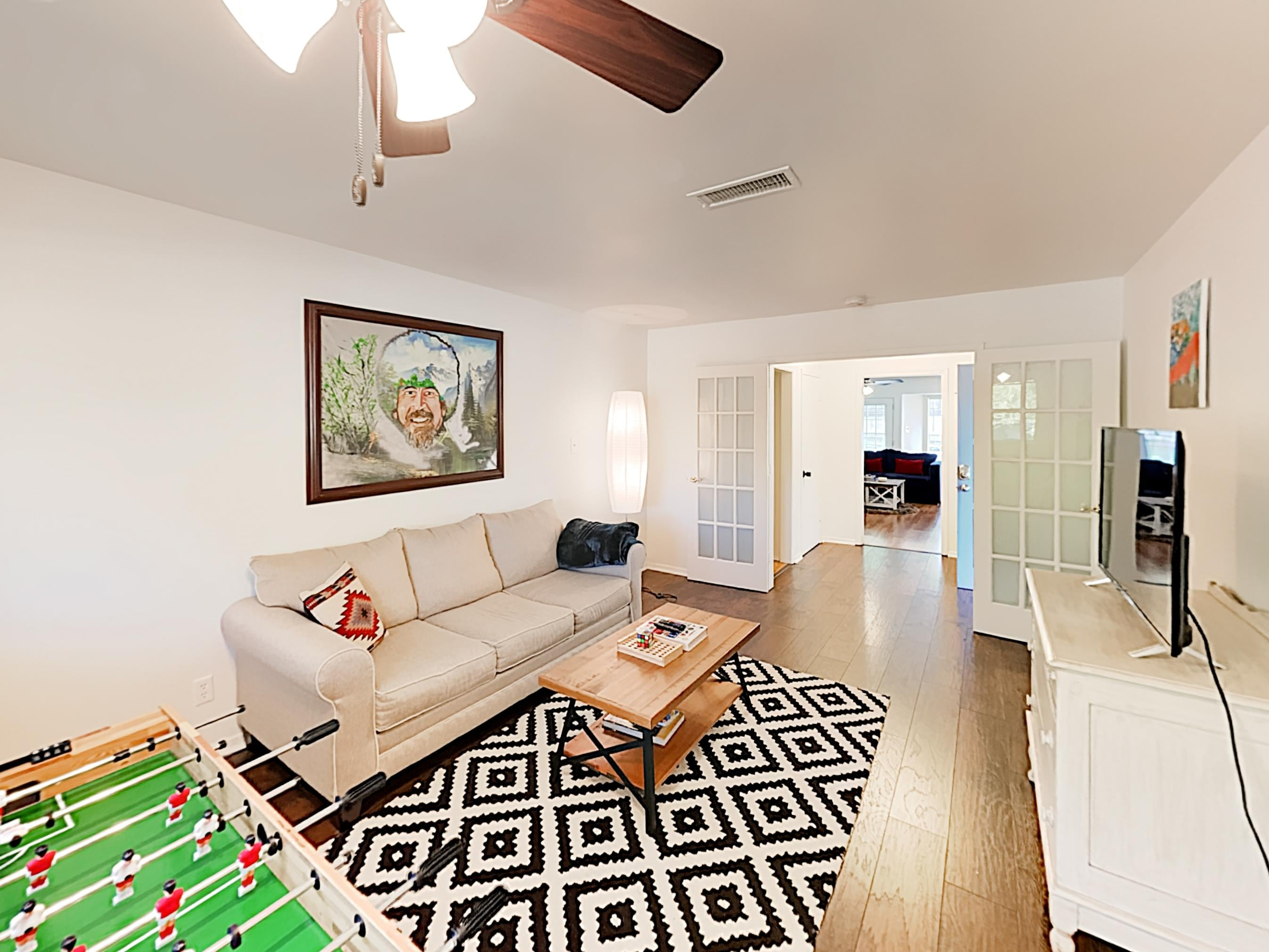 "Find plenty of space in the 2nd living area, furnished with a comfy sleeper sofa, 42"" smart TV, and foosball table."
