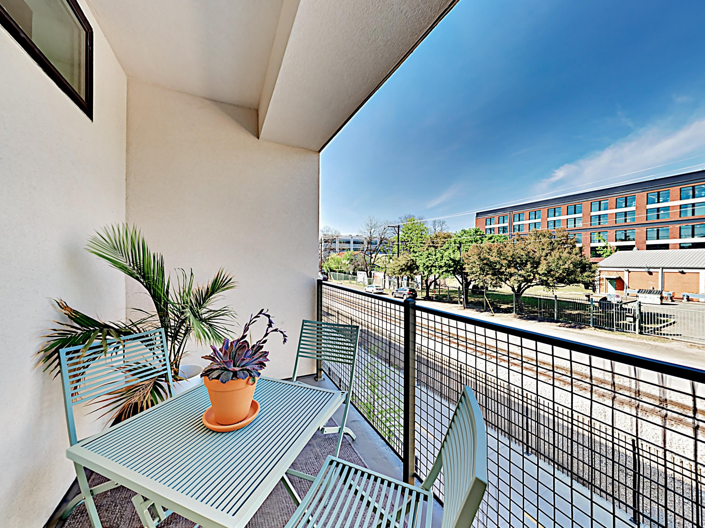 Enjoy the fresh air on your private balcony overlooking East 5th Street.
