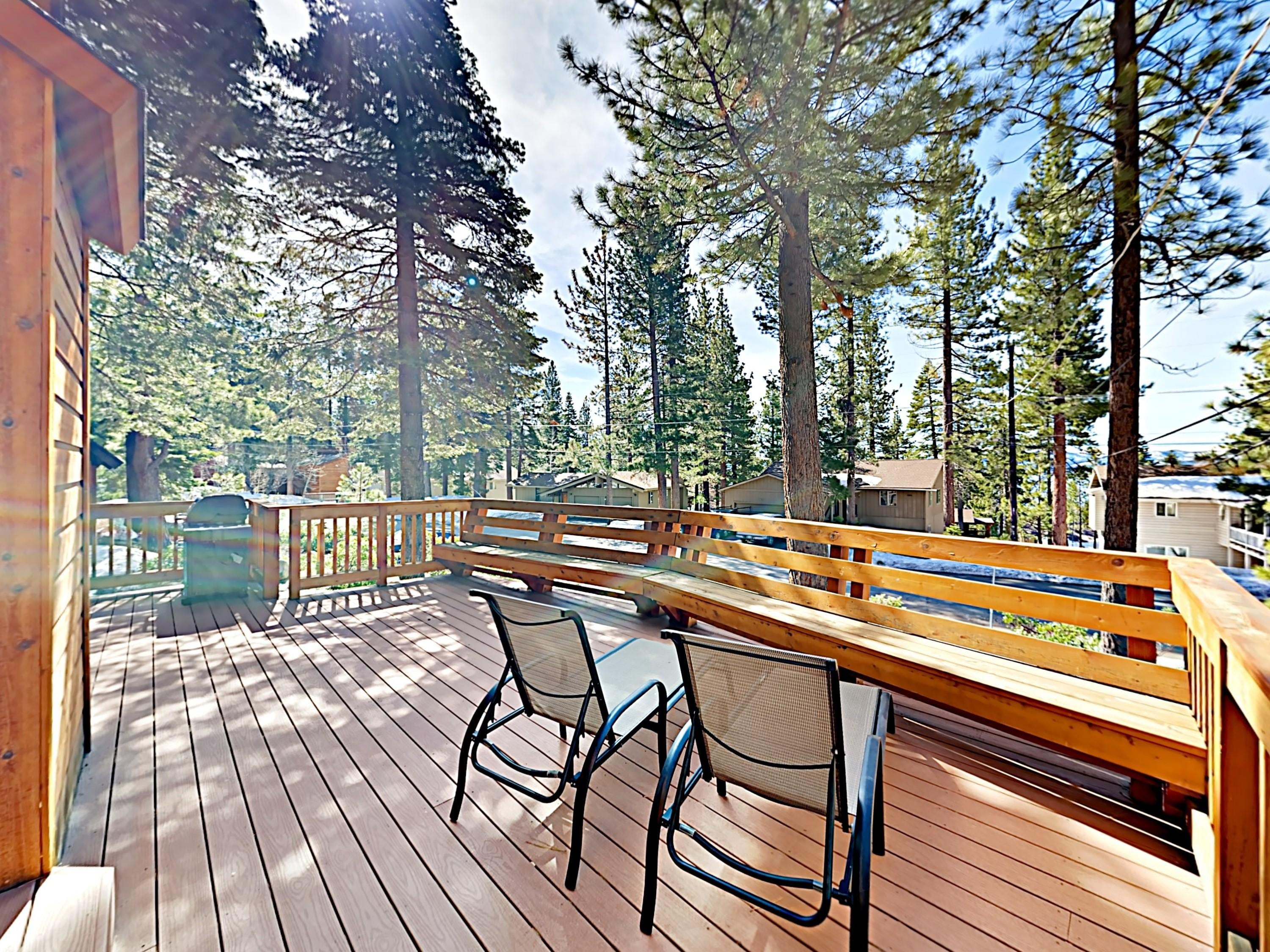 The deck offers a wonderful view of the surrounding pines.