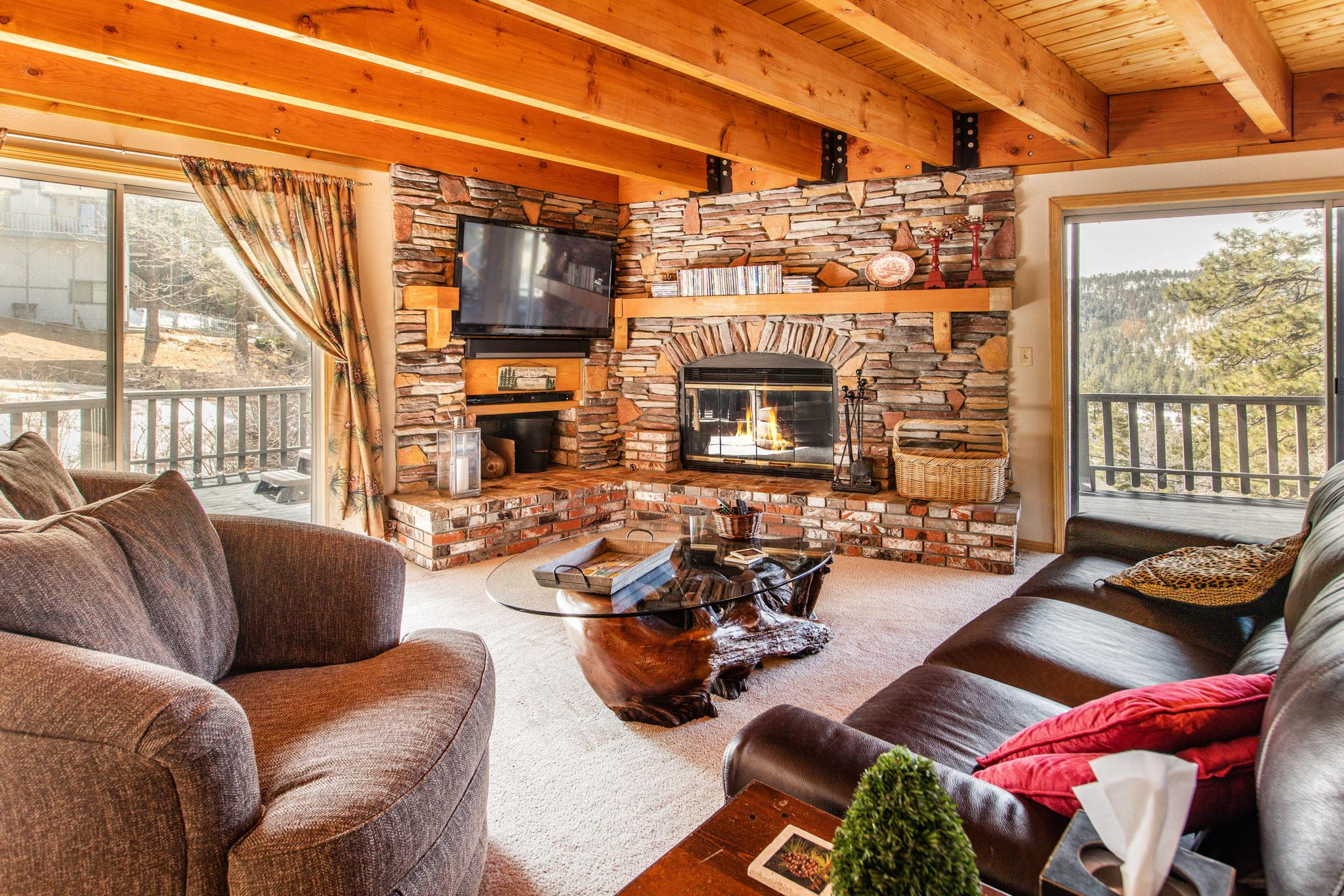 A beautiful main living area combines cozy seating with the comfort of a wood-burning fireplace.
