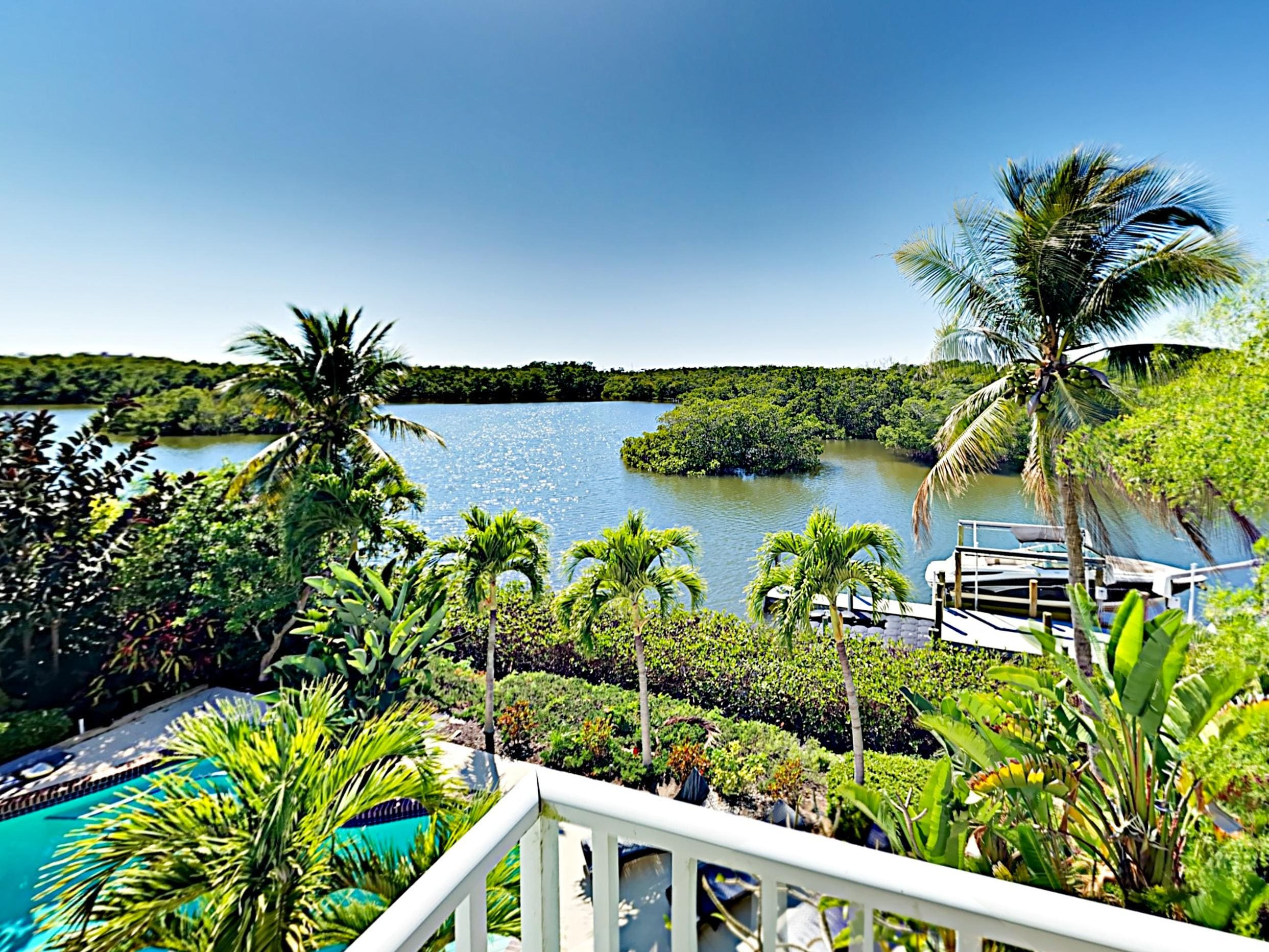 Gorgeous views across the canal and mangroves await on the private balcony.