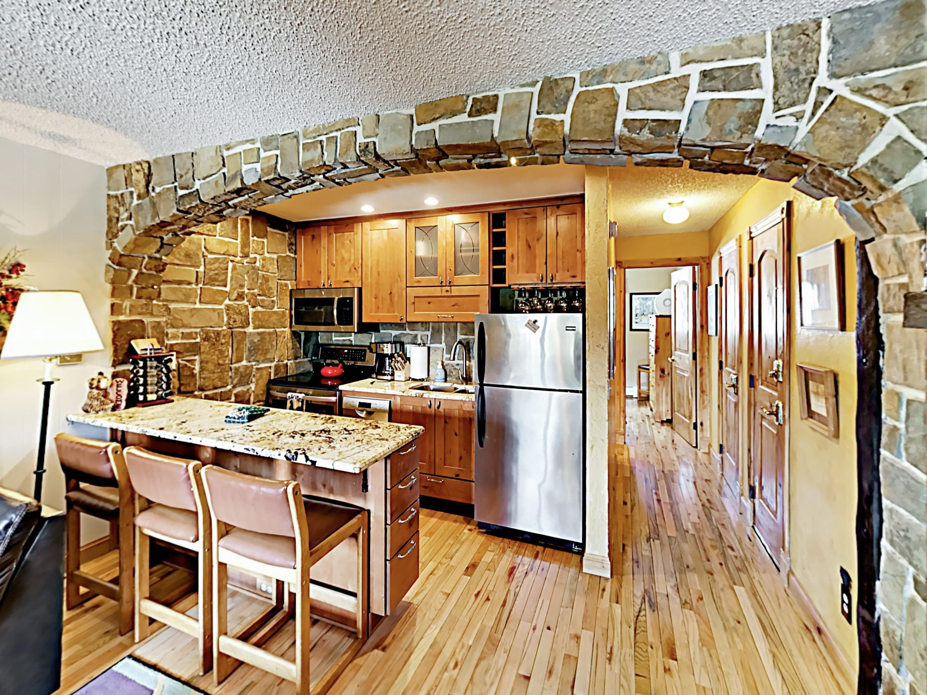 This remodeled unit features stunning stonework, hardwood floors, and granite countertops.
